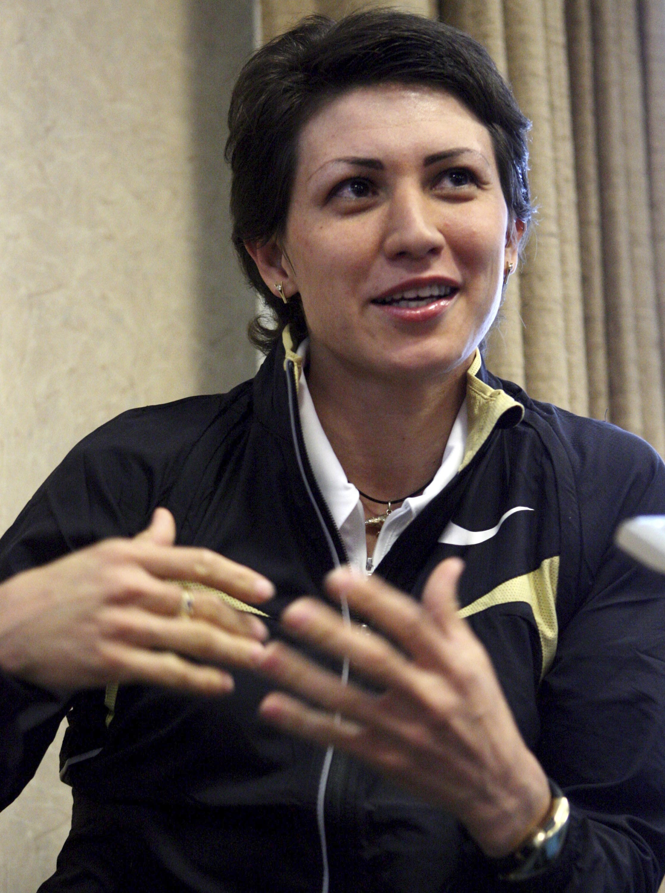 FILE In this Saturday, June 7, 2008 file photo long jumper,Tatyana Lebedeva of Russia, makes remarks during a Prefontaine Classic news conference in Eugene, Ore. The Russian doping scandal hit a high-profile political target Wednesday. Jan. 25, 2017 with