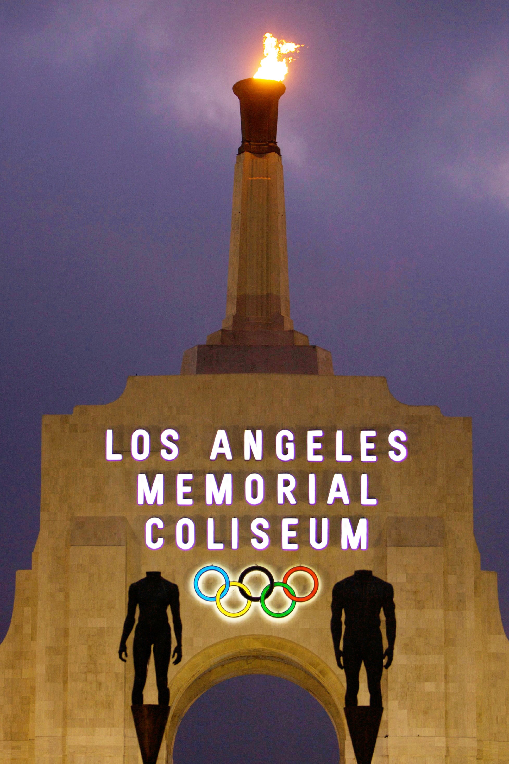 FILE - This Feb. 13, 2008, file photo shows the facade of The Los Angeles Memorial Coliseum in Los Angeles. The Los Angeles bid committee for the 2024 Olympics is projecting a $5.3 billion budget, a number that would be less than half the cost of the rece