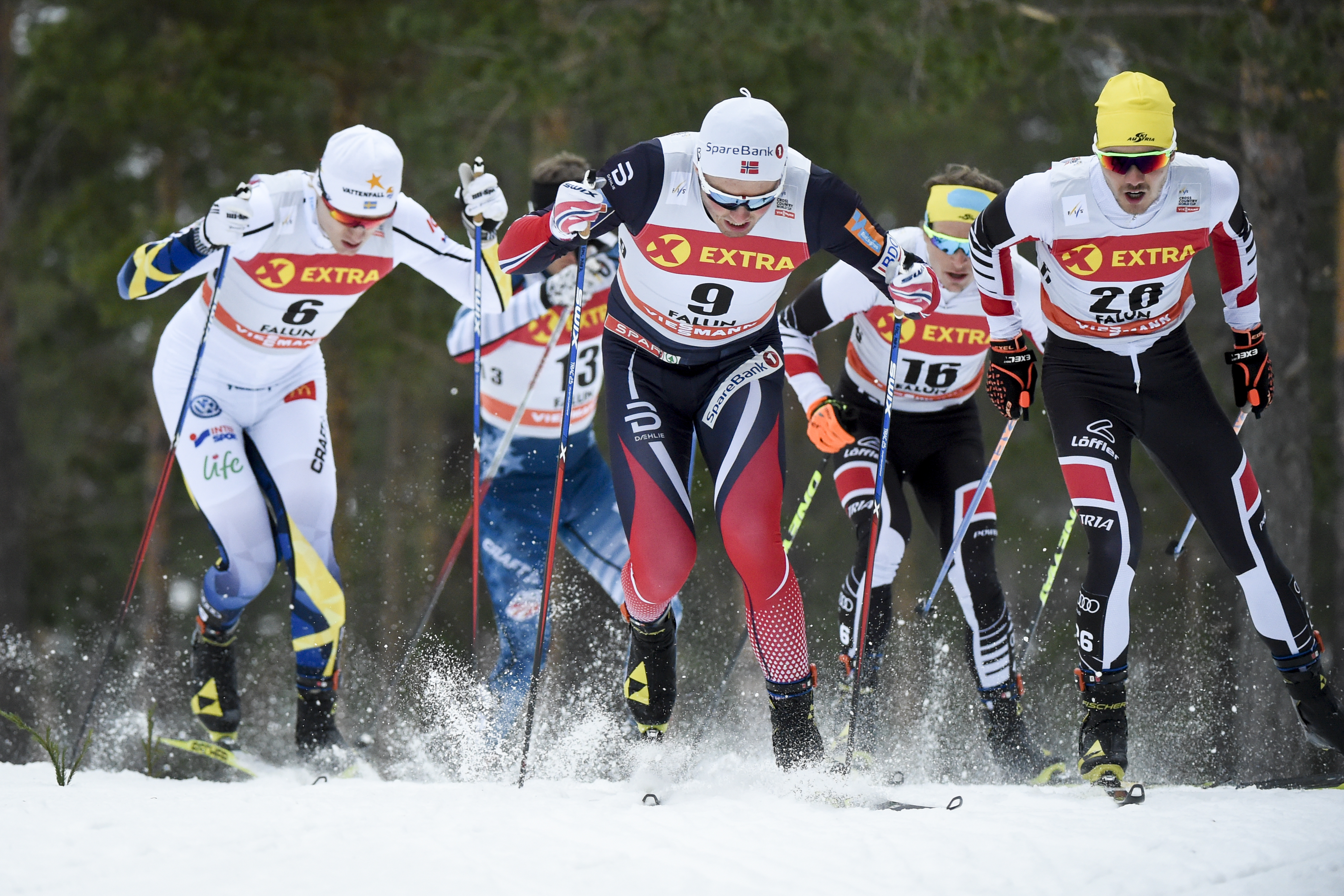 From left Sweden's Oskar Svensson (6), Norway's Emil Iversen, (9), Austria's Bernhard Tritscher (16) and Austria's Dominik Baldauf  ski during the quarter finals of the mens 1.4 km sprint qualification event at the FIS Cross Country World Cup in Falun, Sw
