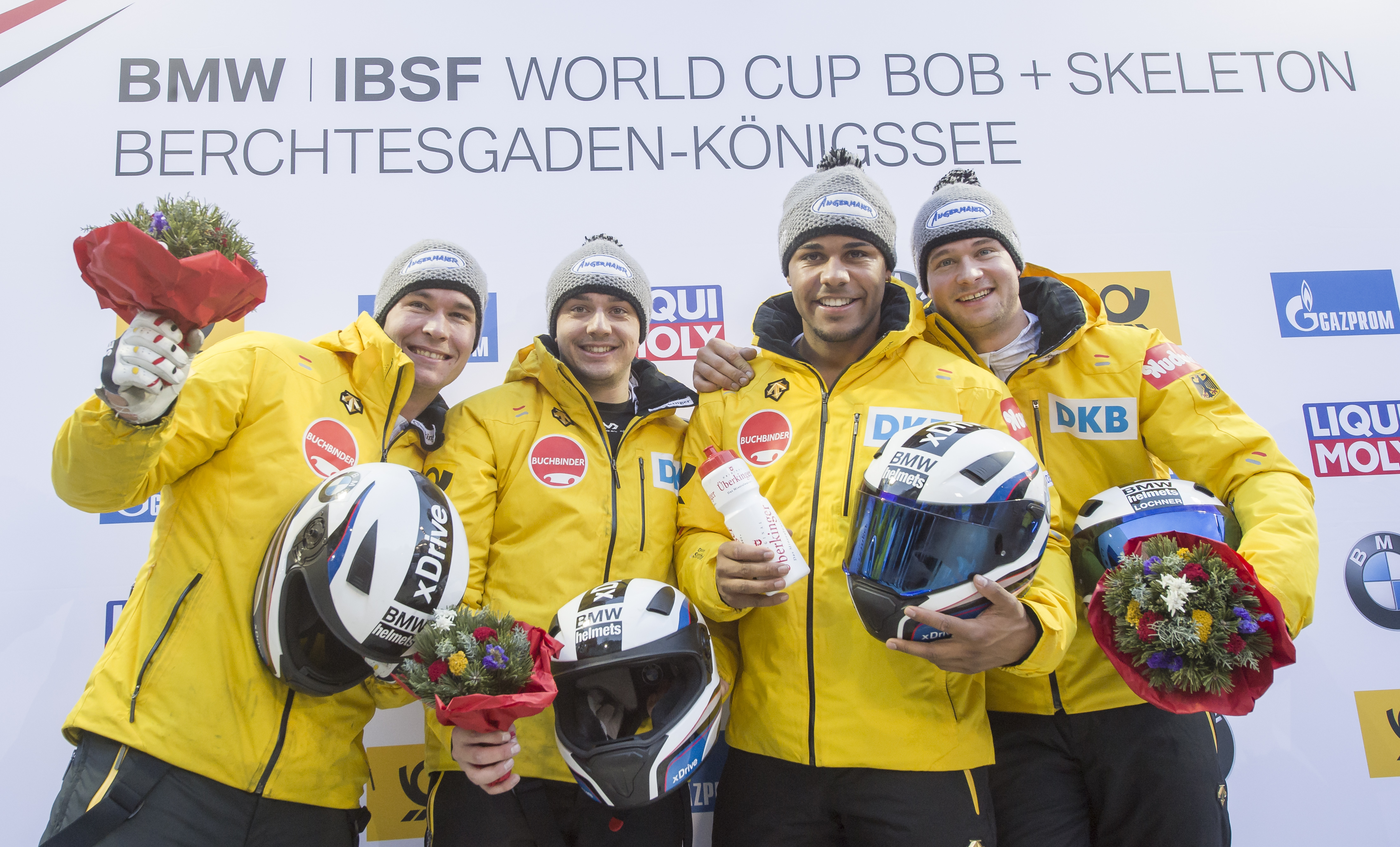 The German winning bobsled team with Johannes Lochner, right, Matthias Kagerhuber, 2nd left, Joshua Bluhm, 2nd right, and Christian Rasp, left, celebrate after the race during the four-men bobsled World Cup at lake Koengissee, Germany, Sunday, Jan. 29, 20