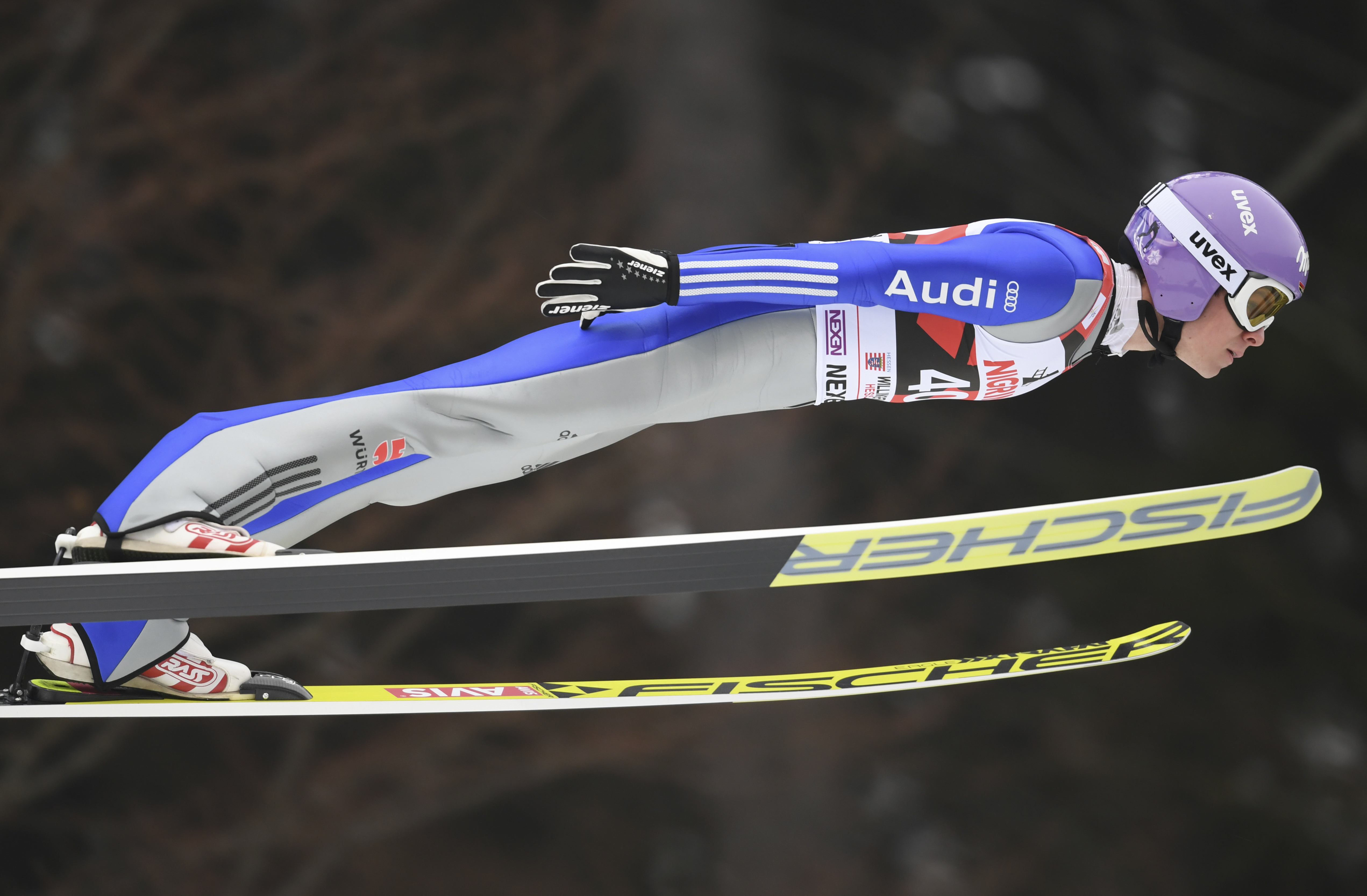 Andreas Wellinger from Germany soars through the air during a trial jump at the ski jumping World Cup in Willingen, Germany, Sunday, Jan. 29, 2017. (Arne Dedert/dpa via AP)