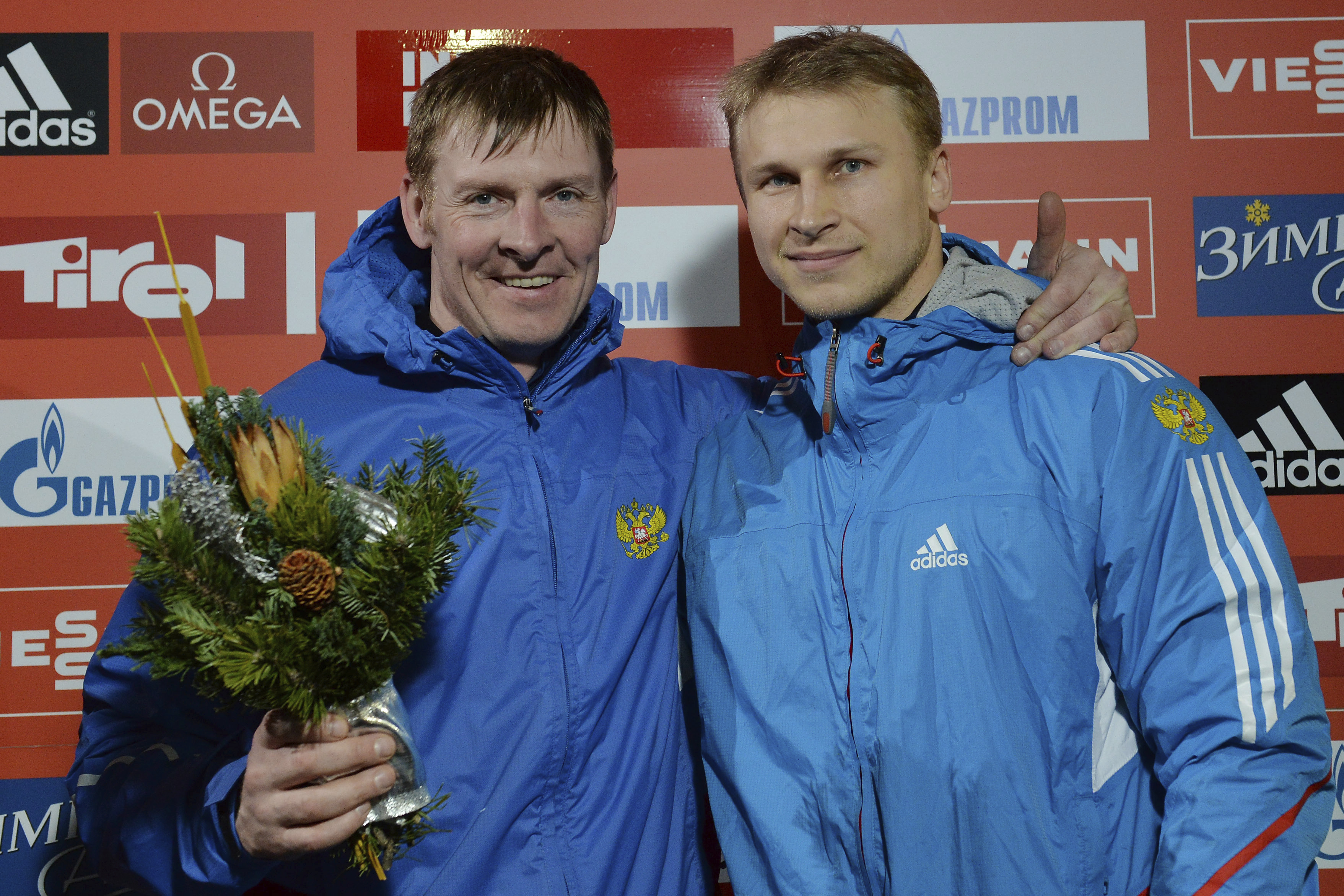 FILE In this Saturday, Jan. 18. 2014 file photo Russia's third placed Alexander Zubkov, left, and Dmitry Trunenkov pose for media after the two-men bob race at the Bob World Cup in Innsbruck, Austria. The Russian Anti-Doping Agency said Tuesday, Jan. 31,