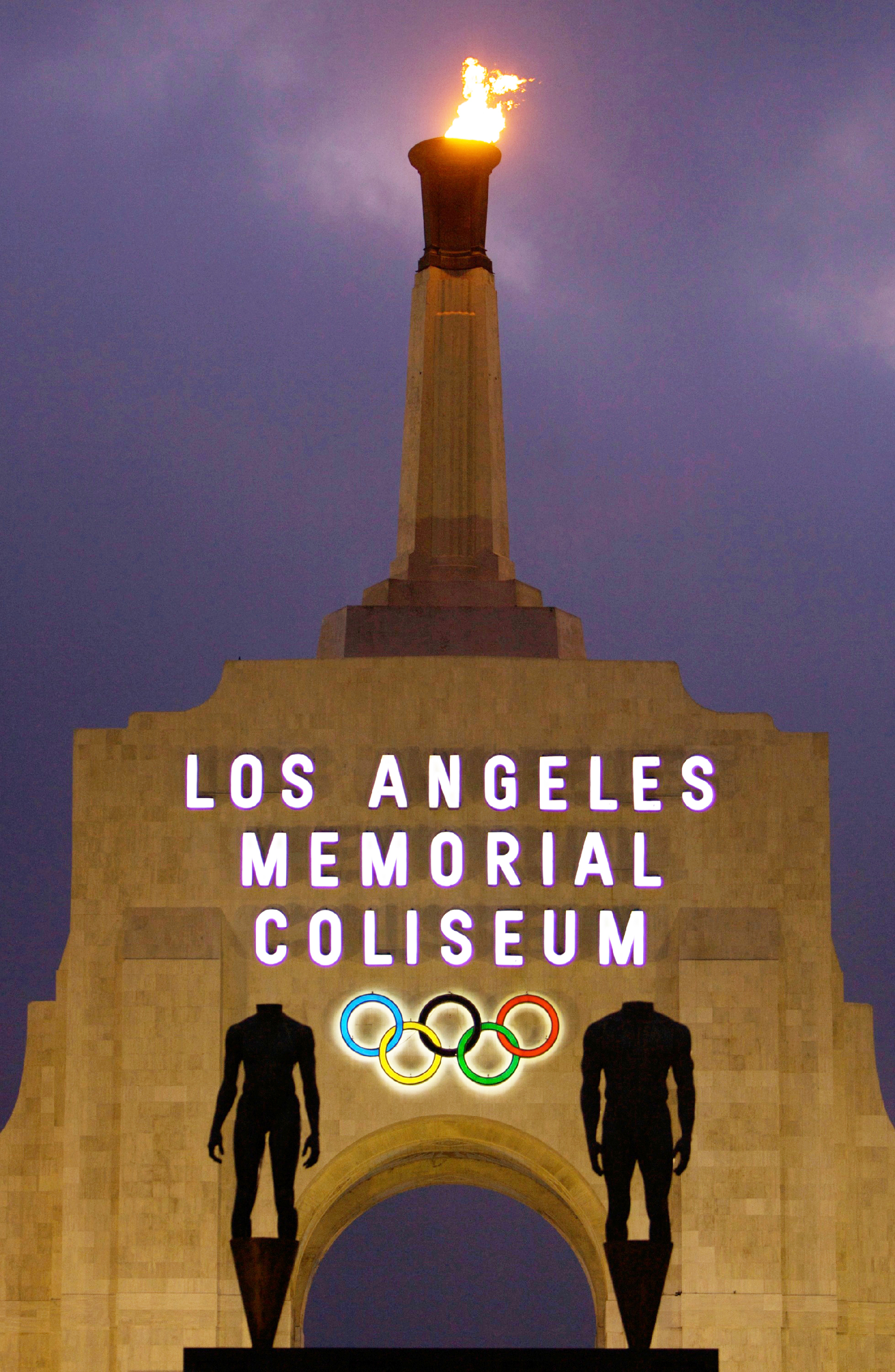 FILE - This Feb. 13, 2008, file photo shows the facade of Los Angeles Memorial Coliseum in Los Angeles. Los Angeles Olympic planners competing for the 2024 Games promised Thursday, Feb. 2, 2017, to help restore credibility and stability to international s