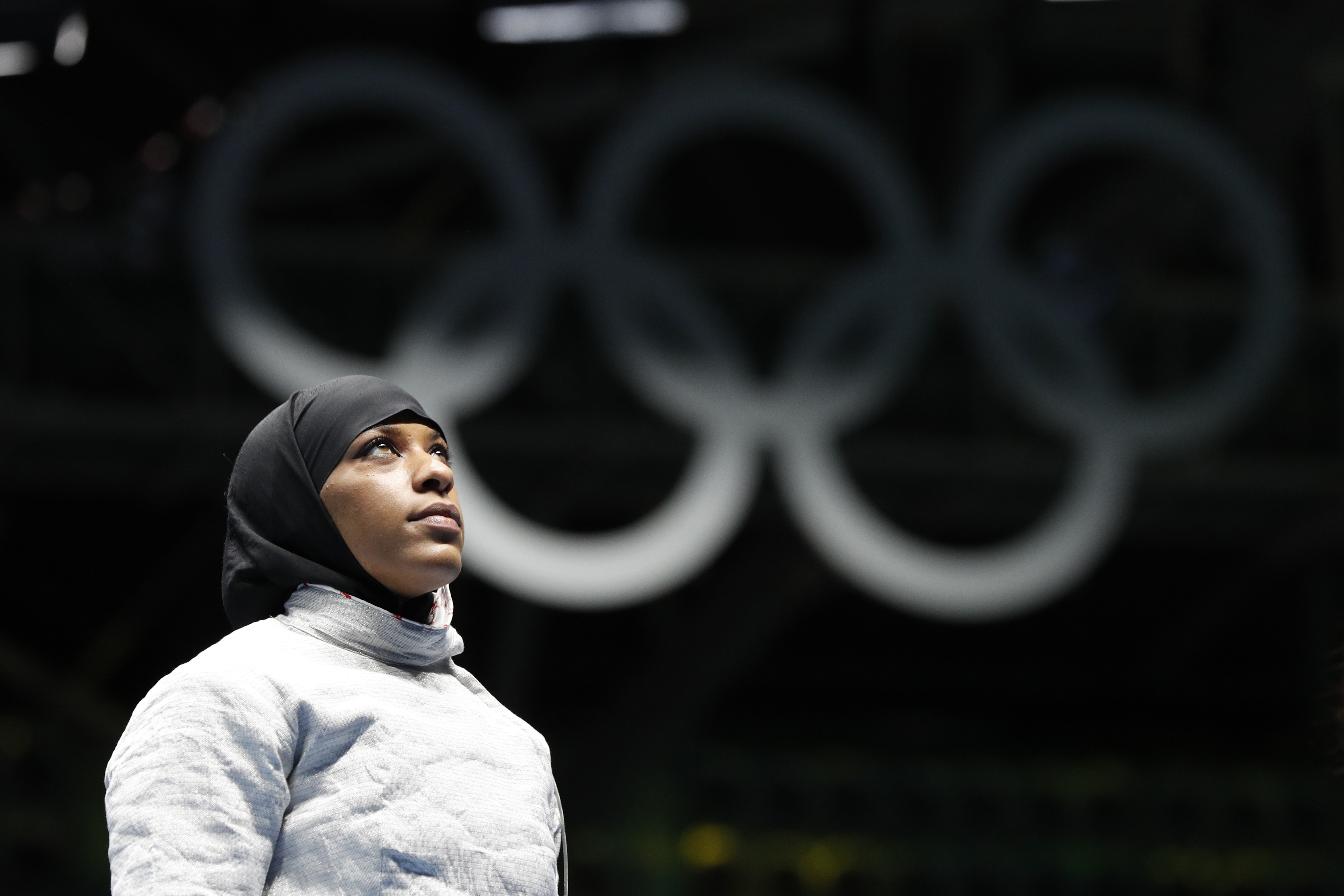 FILE- In this Aug. 8, 2016, file photo, Ibtihaj Muhammad, from United States, waits for match against Olena Kravatska from Ukraine, in the women's saber individual fencing event at the Summer Olympics in Rio de Janeiro. International basketball competitio