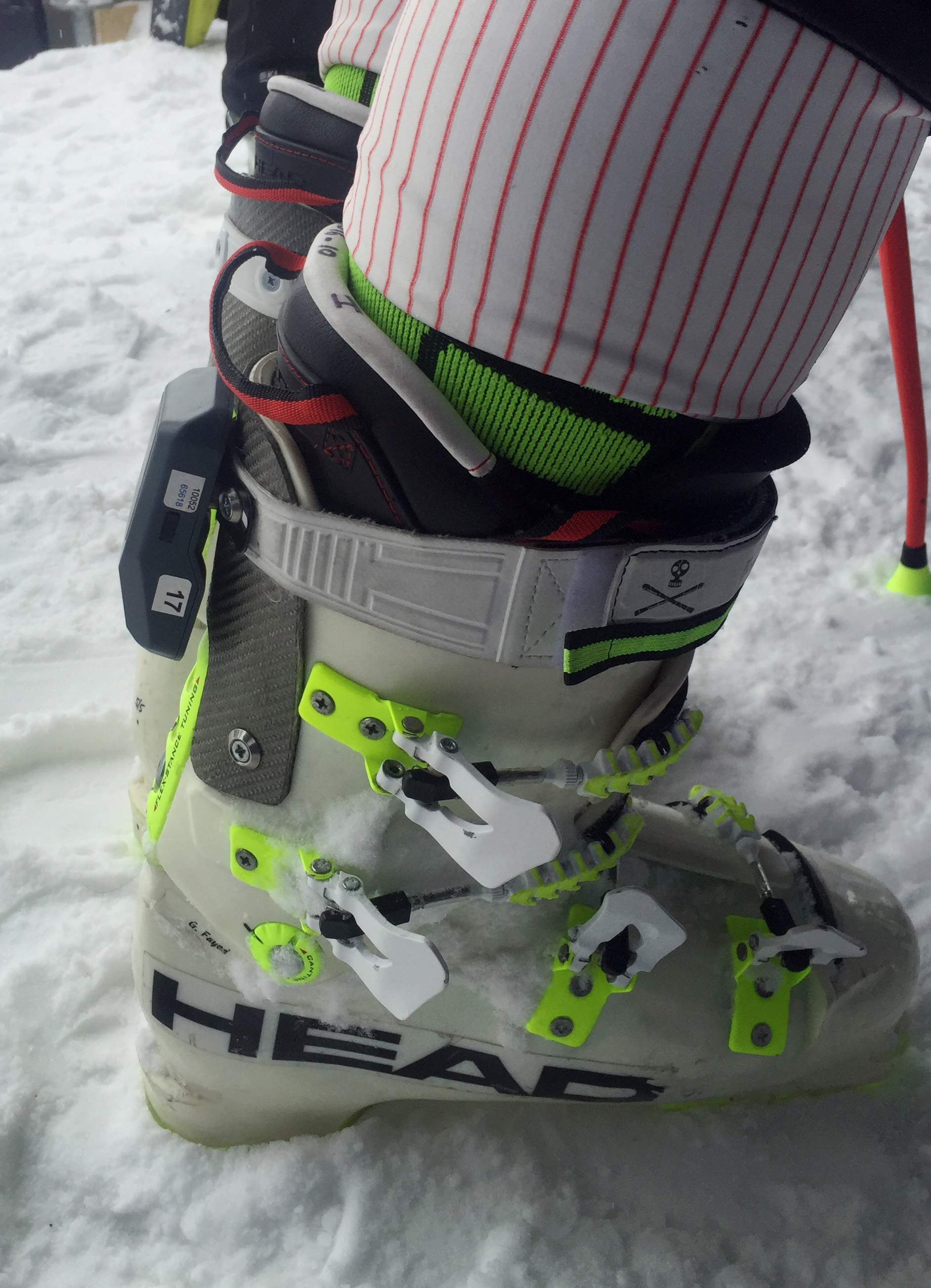 In this Dec. 2016 photo supplied by the International Ski Federation, a transponder is attached to the back of Alpine racer France's Guillermo Fayed's ski boot in Val d'Isere, France. The transponder can relay speed and timing data to provide real-time gr