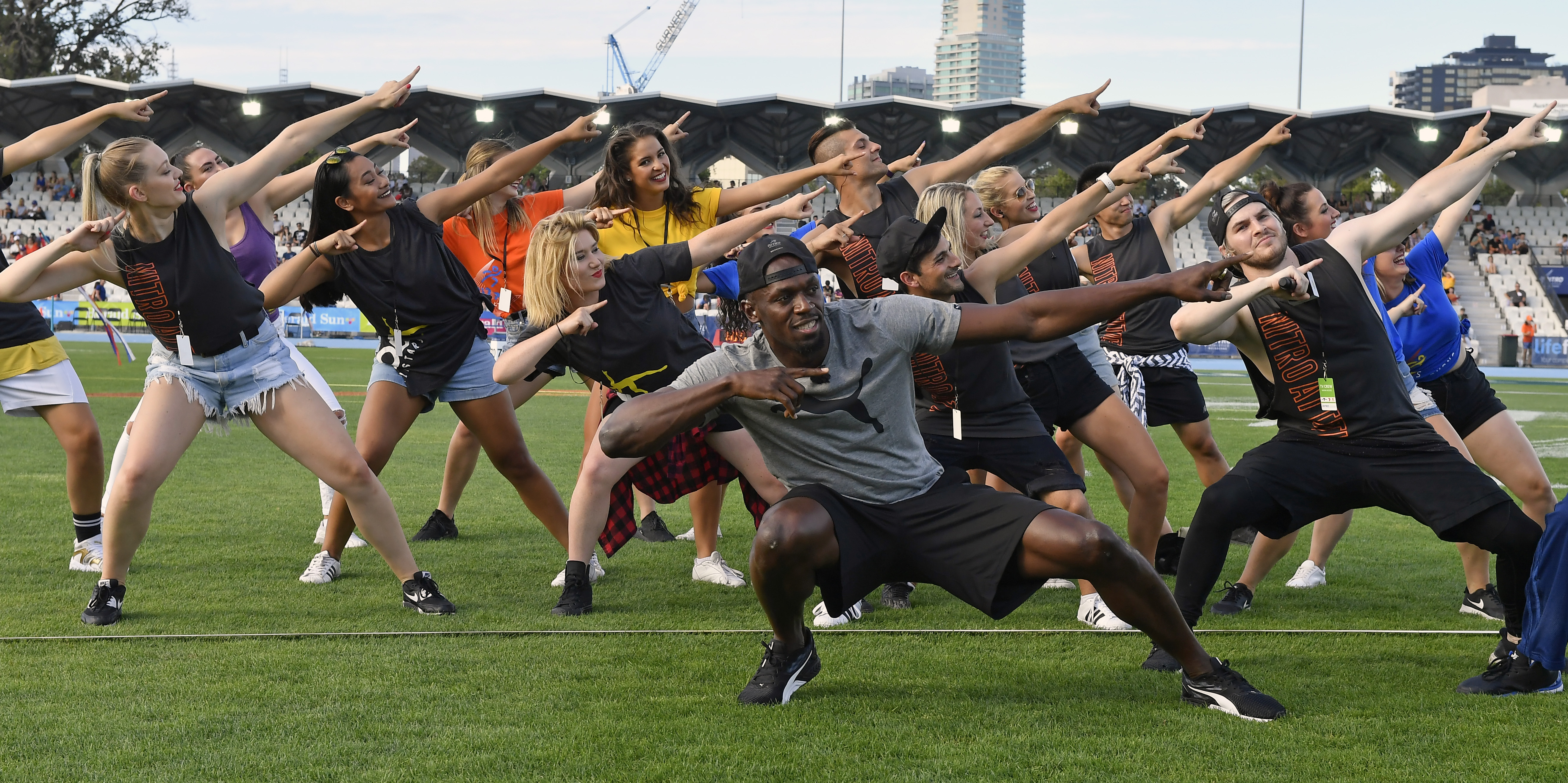 Jamaica's Usain Bolt entertains the crowd before the start of the Nitro Athletics meet in Melbourne, Australia, Saturday, Feb. 04, 2017. (AP Photo/Andy Brownbill)