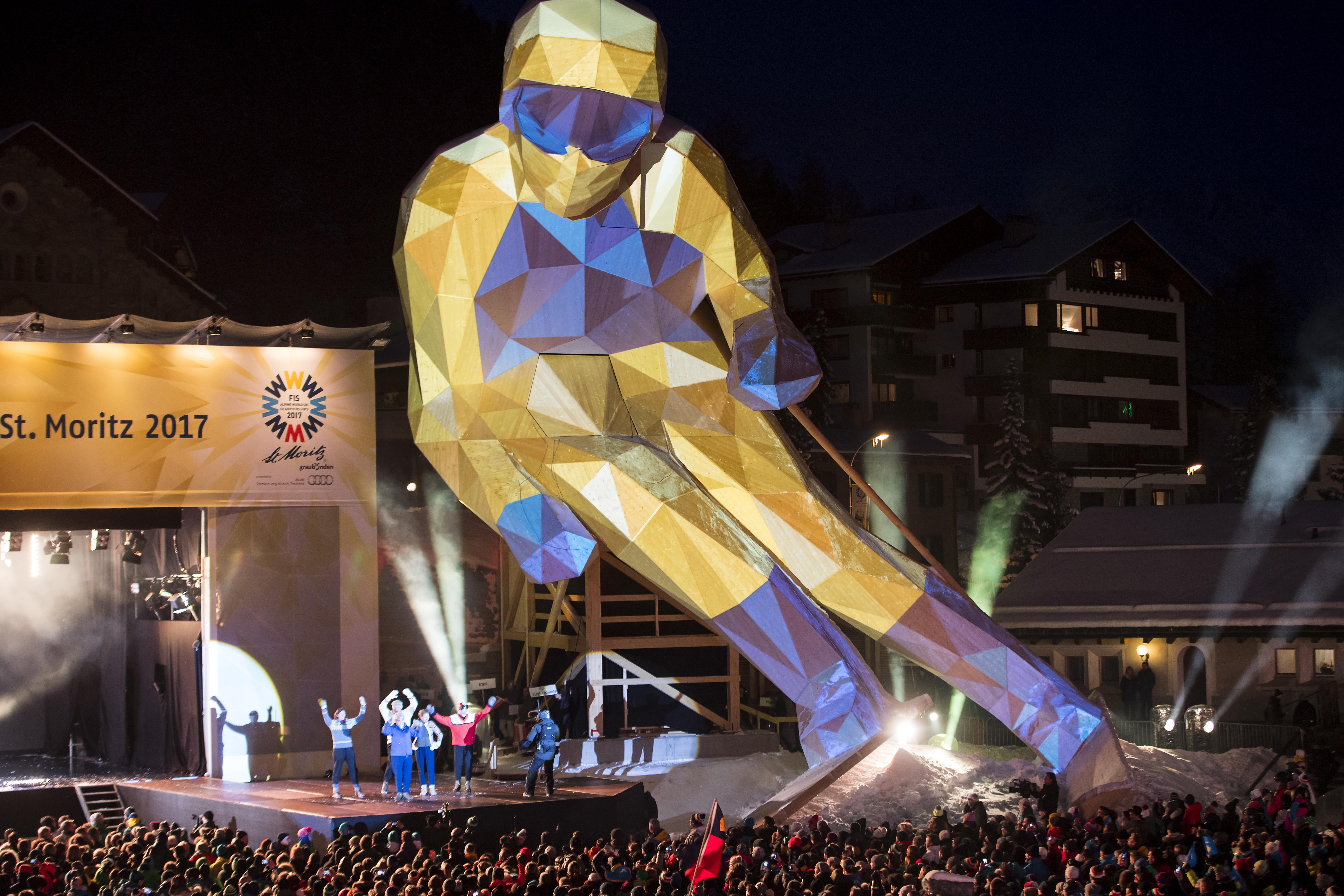 People attend the opening ceremony of the 2017 FIS Alpine Skiing World Championships in St. Moritz, Switzerland, Monday, Feb. 6, 2017.  (Jean-Christophe Bott/Keystone via AP)