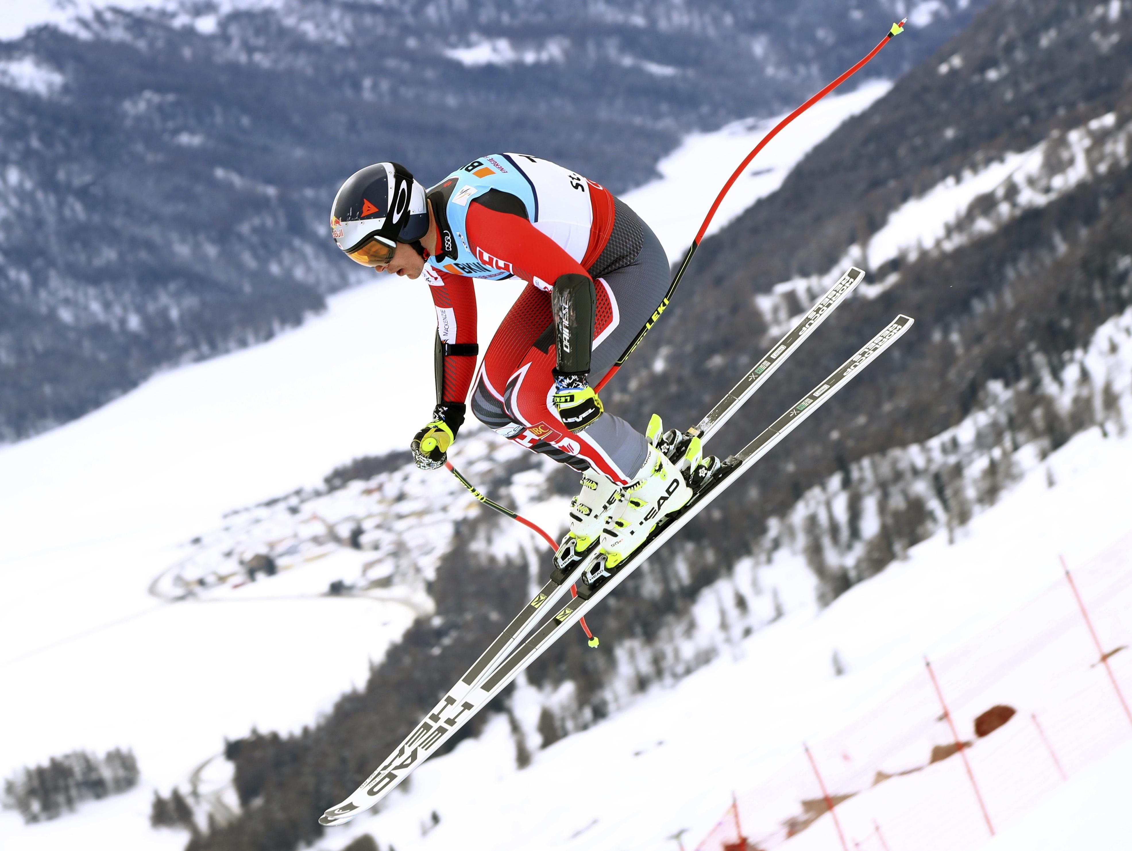 Canada's Erik Guay is airborne during a men's super-G, at the alpine ski World Championships, in St. Moritz, Switzerland, Wednesday, Feb. 8, 2017. (AP Photo/Alessandro Trovati)