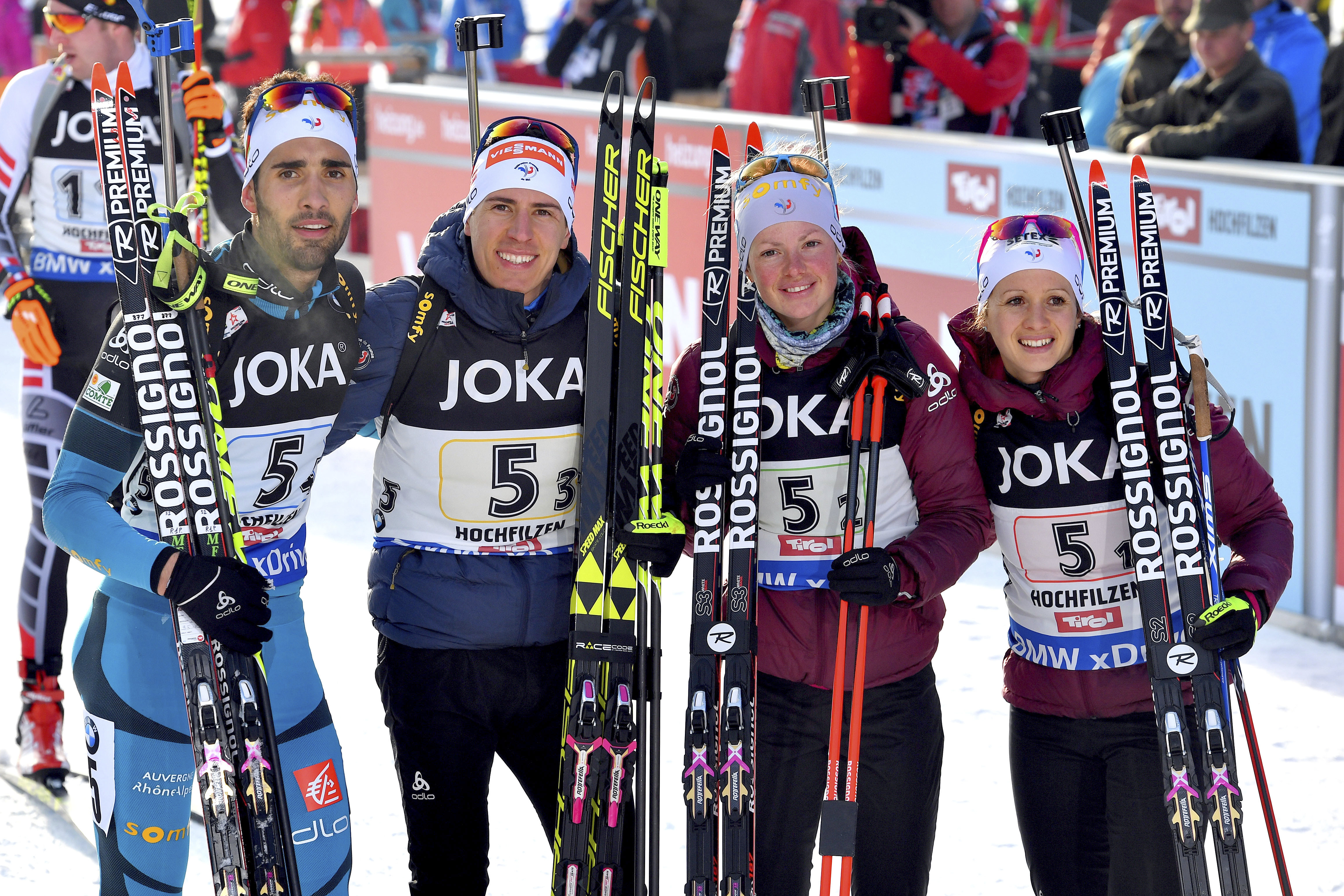 France's second placed  team with from left : Martin Fourcade,  Quentin Fillon Maillet, Marie Dorin Habert and Anais Chevalier pose for media after the Mixed relay competition of the Biathlon World Championships in Hochfilzen, Austria, Thursday, Feb. 9, 2