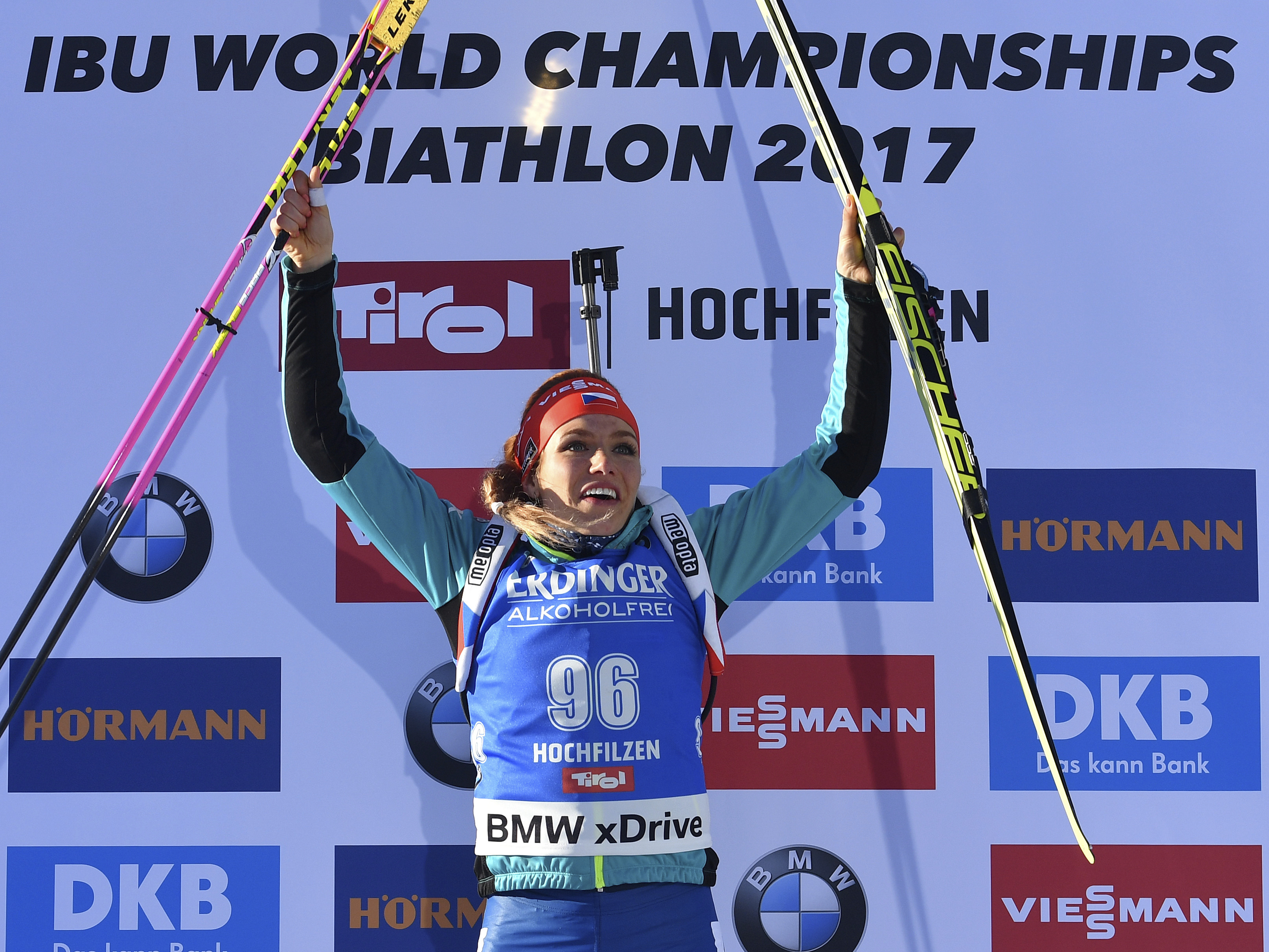 Czech Republic's winner Gabriela Koukalova celebrates on the podium after the women's 7.5 km sprint competition at the Biathlon World Championships in Hochfilzen,  Austria, Friday, Feb. 10, 2017. (AP Photo/Kerstin Joensson)
