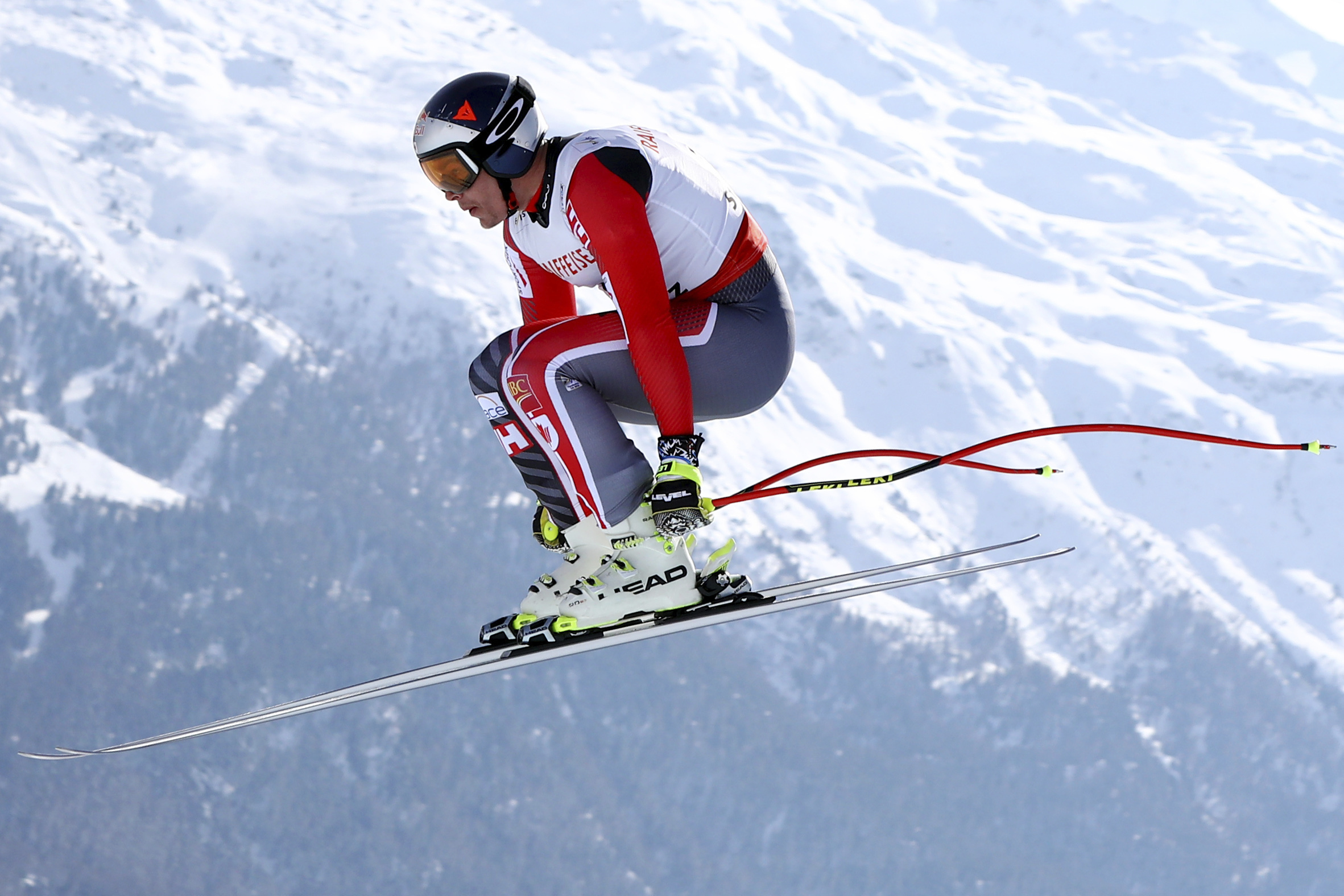 Canada's Erik Guay competes during a men's downhill race, at the alpine ski World Championships in St. Moritz, Switzerland, Sunday, Feb.12, 2017. (AP Photo/Alessandro Trovati)