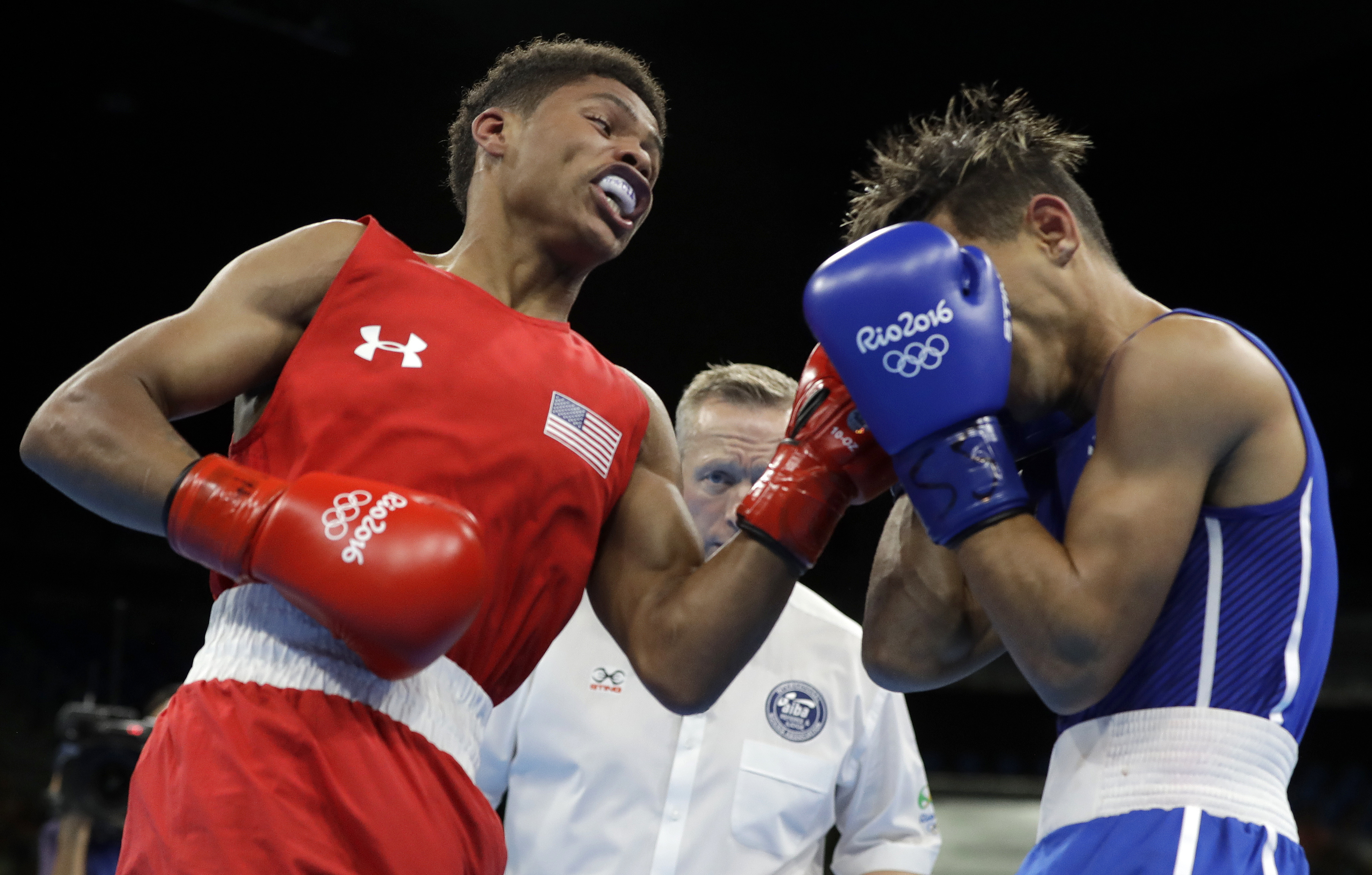 FILE - In this Aug. 20, 2016, file photo, United States' Shakur Stevenson, left, fights Cuba's Robeisy Ramirez during a men's bantamweight 56-kg final boxing match at the 2016 Summer Olympics in Rio de Janeiro, Brazil. Stevenson believes he is destined fo