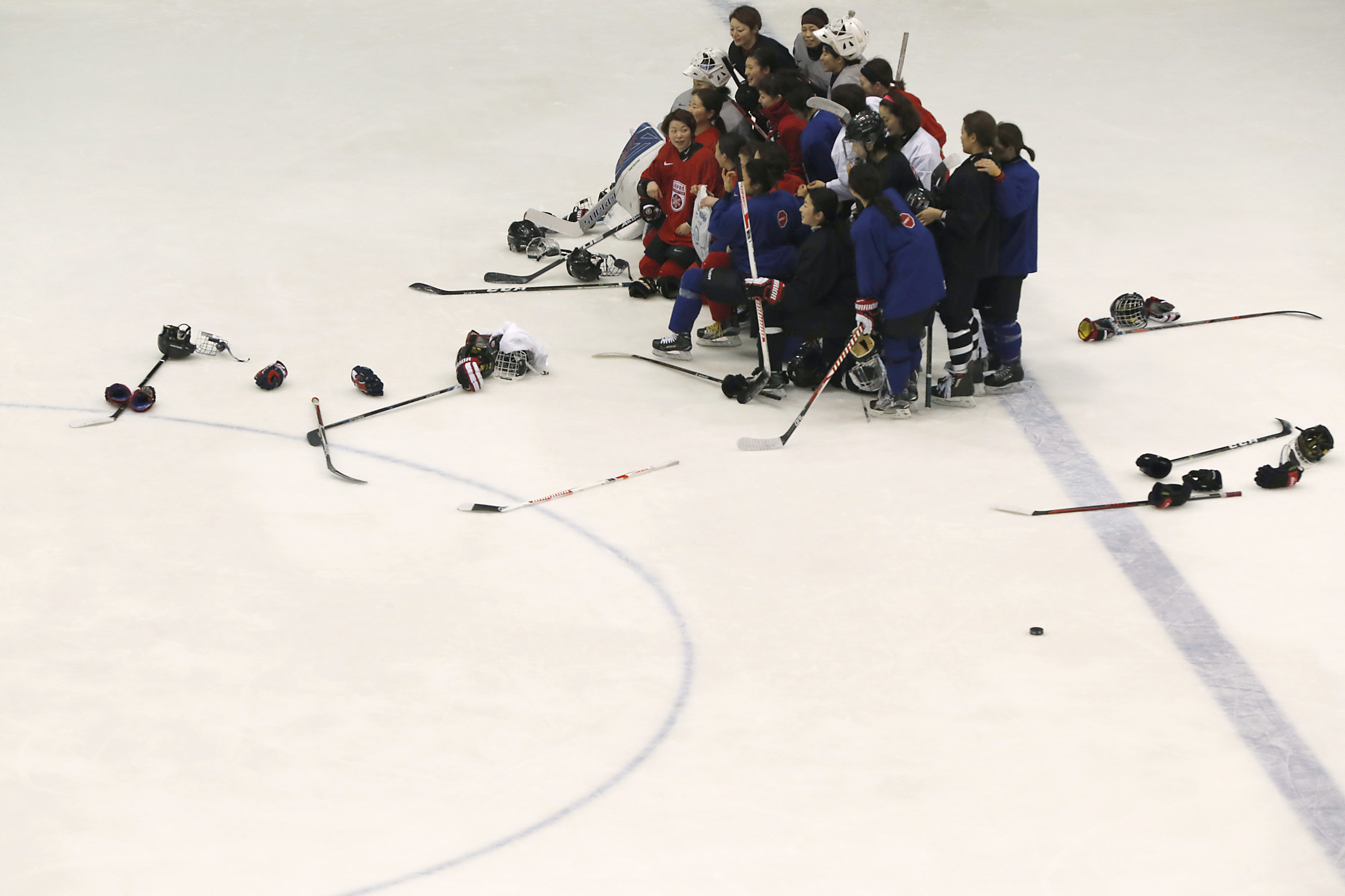 Members of the Japanese women's national ice hockey team pose for their group photo after their practice session for the Asian Winter Games at Tsukisamu Gymnasium in Sapporo, on Japan's northern island of Hokkaido, Friday, Feb. 17, 2017. With the Winter O
