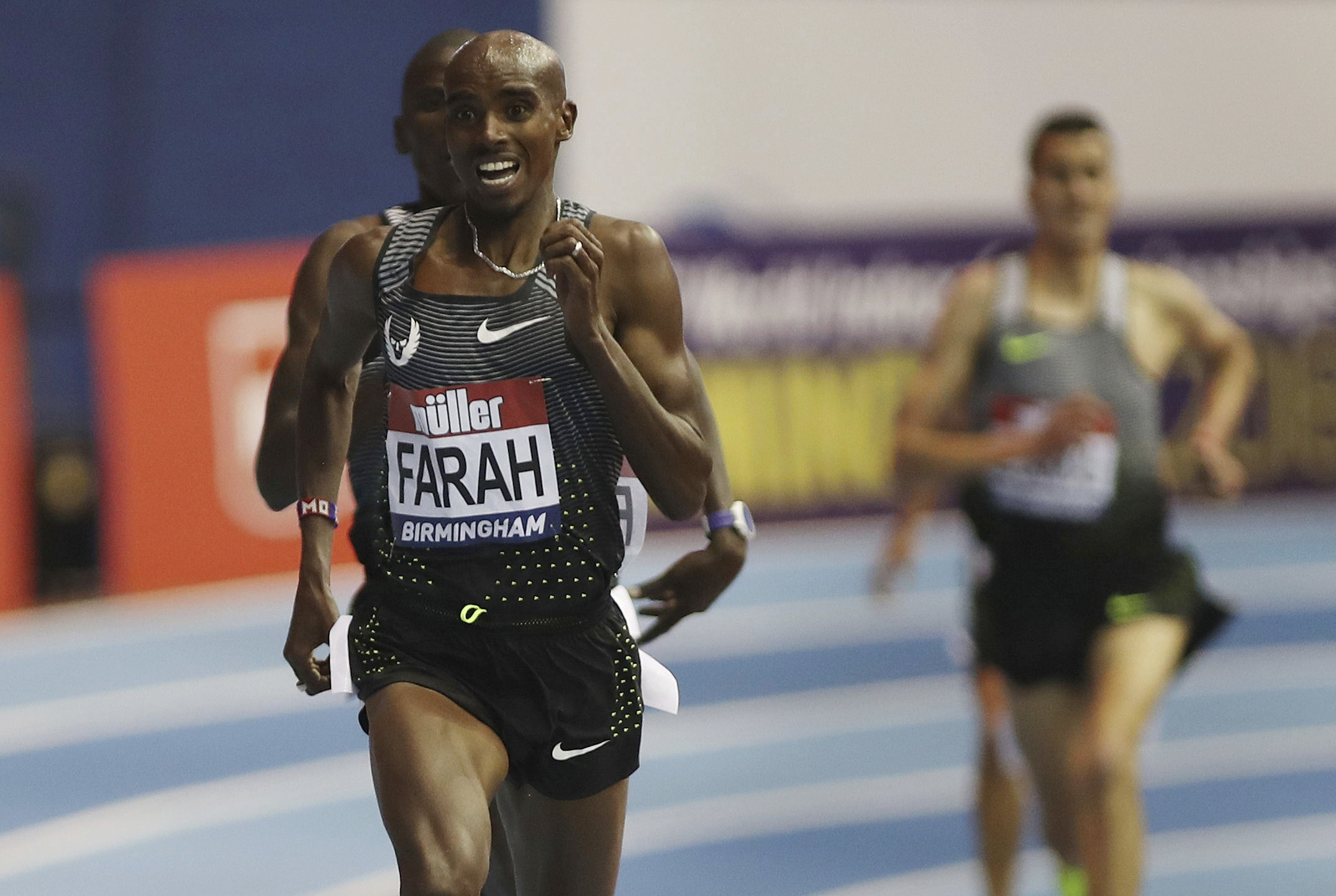 Britain's Mo Farah wins the 5000m during the Indoor Grand Prix at the Barclaycard Arena, Birmingham, England, Saturday Feb. 18, 2017. (David Davies/PA via AP)