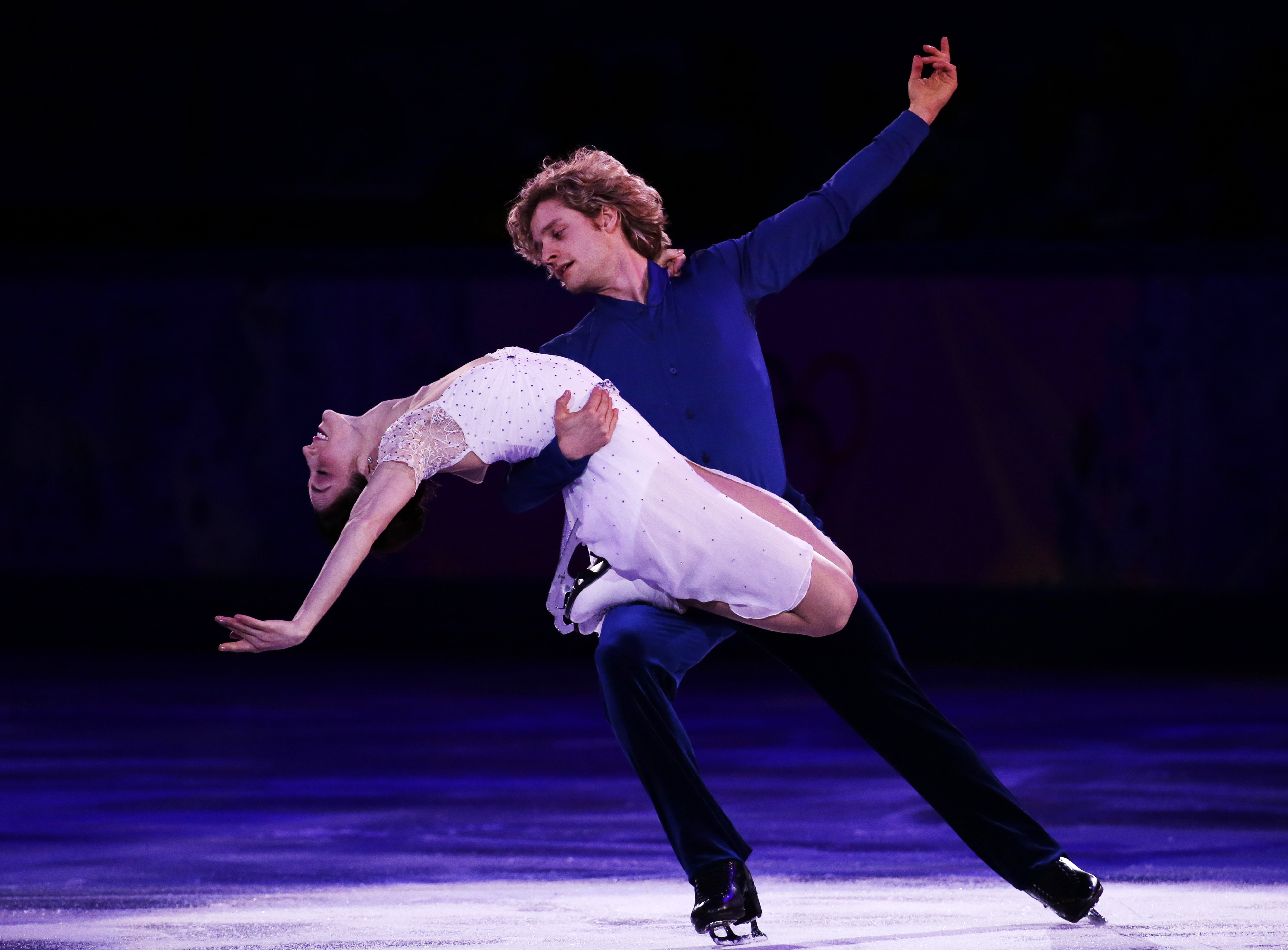 FILE - In this Feb. 22, 2014 file photo, Meryl Davis and Charlie White of the United States perform during the figure skating exhibition gala at the Iceberg Skating Palace during the 2014 Winter Olympics in Sochi, Russia.  Davis and  White won't be defend