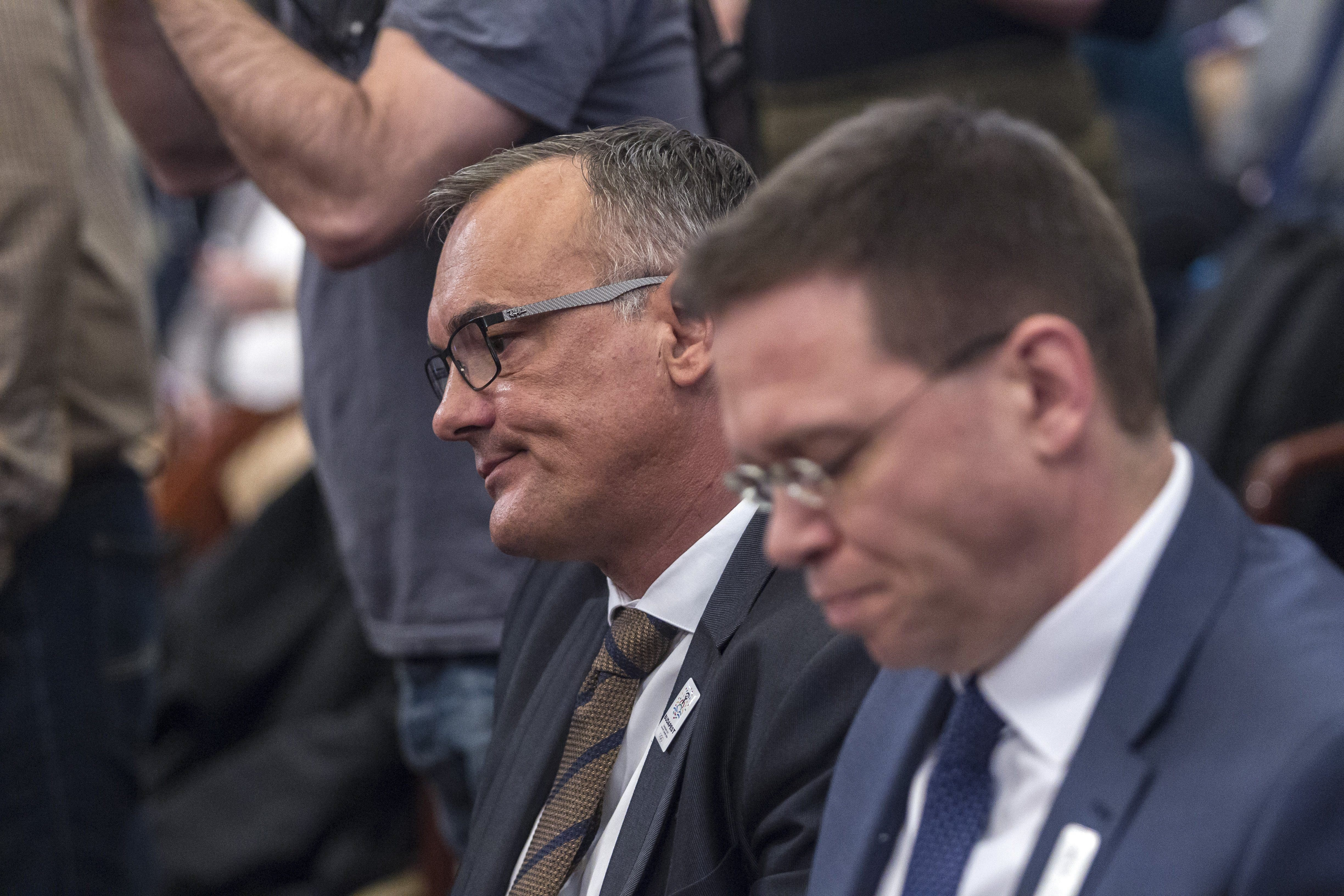 President of the Hungarian Olympic Committee Zsolt Borkai, left, and Head of the bid of Budapest for hosting the 2024 Summer Olympic Games Balazs Furjes attend a session of the General Assembly of the City of Budapest in the town hall in Budapest, Hungary