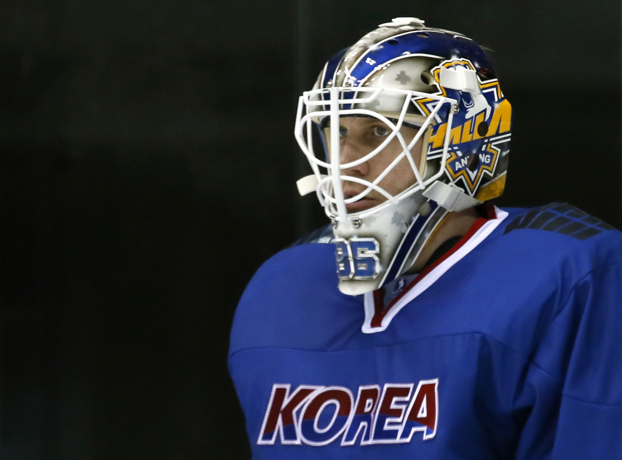 In this Feb. 22, 2017 photo, South Korea's goalkeeper Matt Dalton watches teammates' play in their ice hockey men's top division match against Kazakhstan at the Asian Winter Games in Sapporo, northern Japan. Growing up in rural southern Ontario, Dalton ne