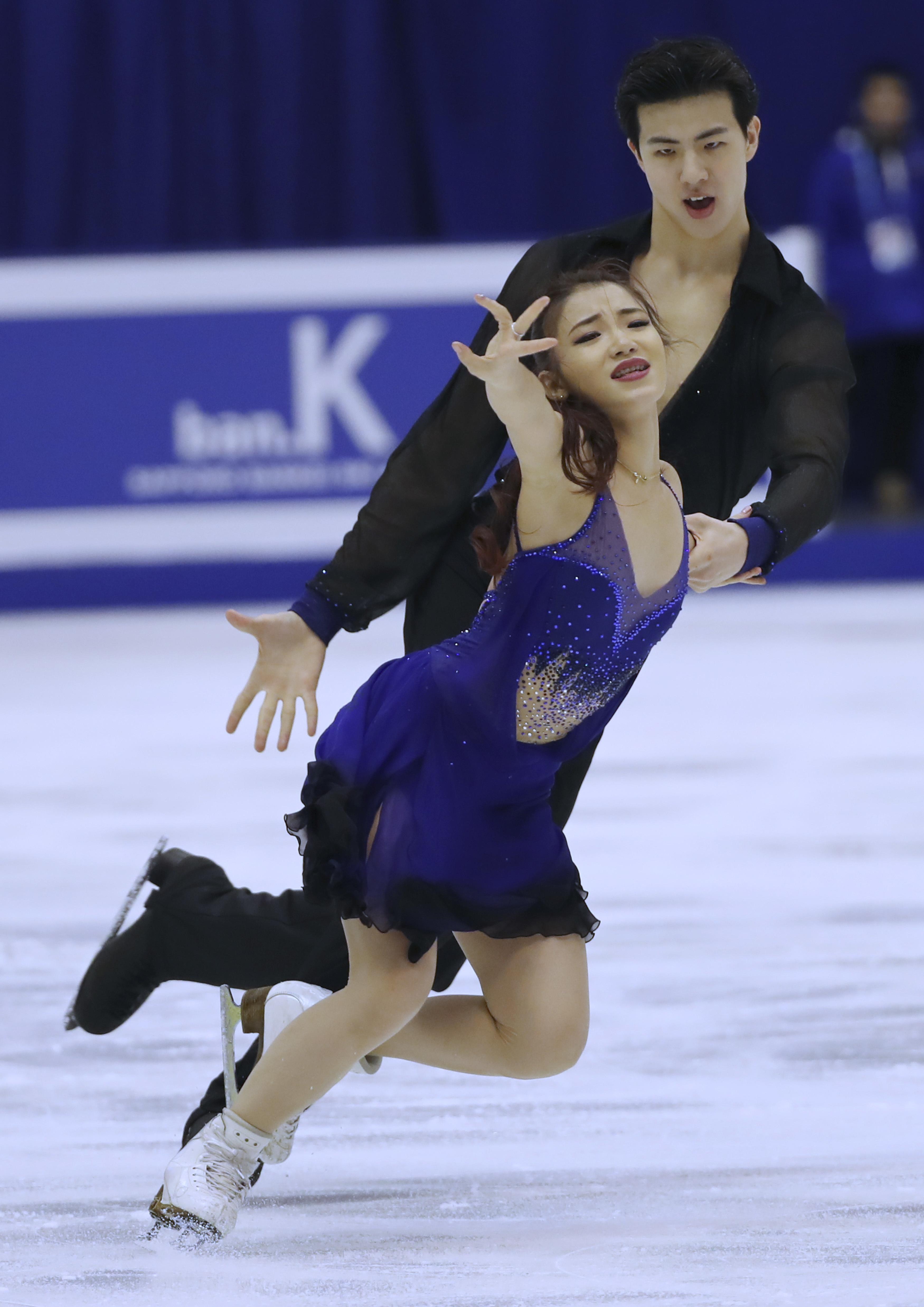 Wang Shiyue and Liu Xinyu of China perform during an Ice Dance Short Distance at Makomanai Indoor Skating Rink at the Asian Winter Games in Sapporo, northern Japan, Thursday, Feb. 23, 2017. (AP Photo/Eugene Hoshiko)