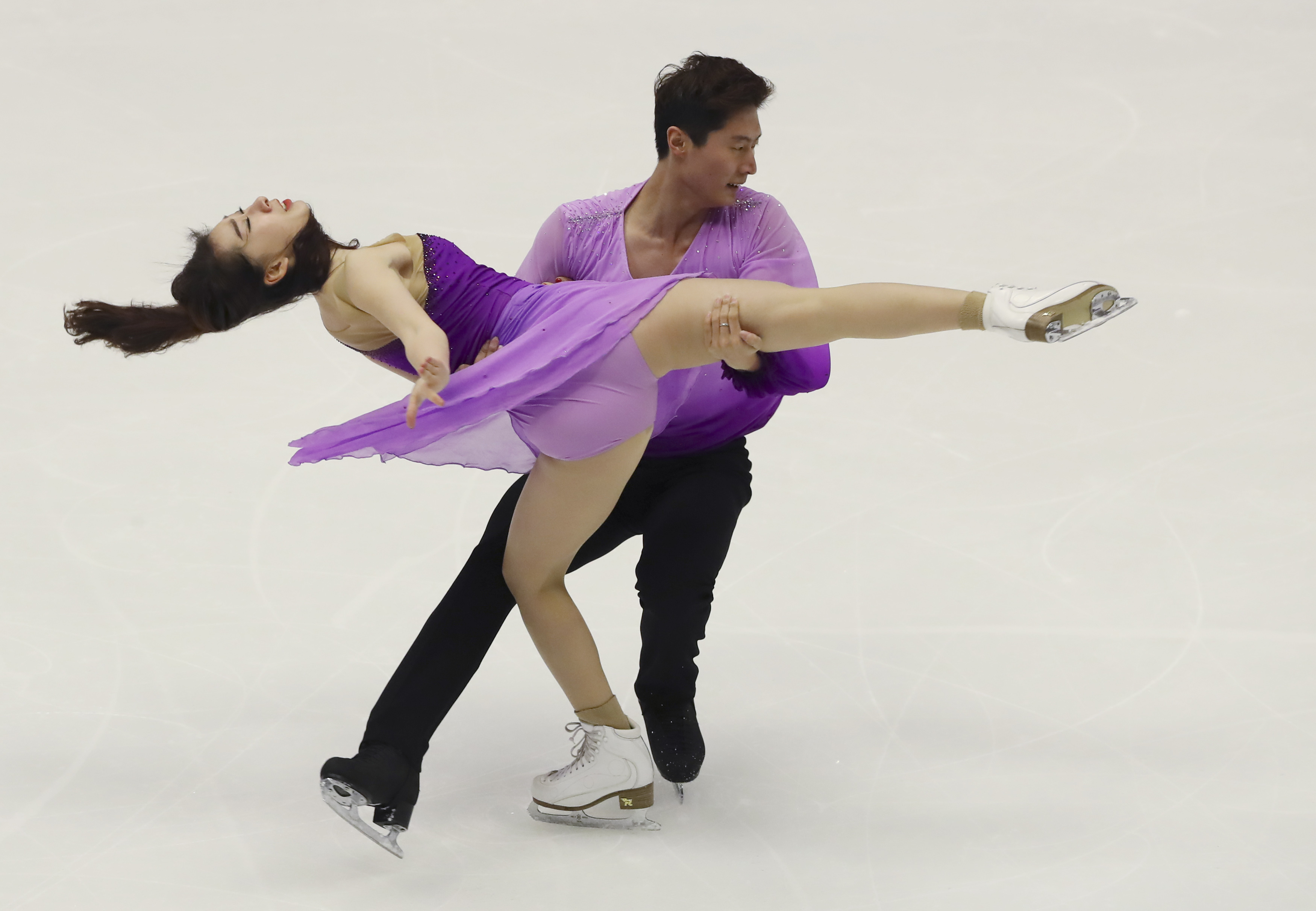 Chen Hong and Zhao Yan of China perform in the Ice Dance Free Dance program of Figure Skating competition at Makomanai Indoor Skating Rink at the Asian Winter Games in Sapporo, northern Japan, Friday, Feb. 24, 2017. (AP Photo/Eugene Hoshiko)