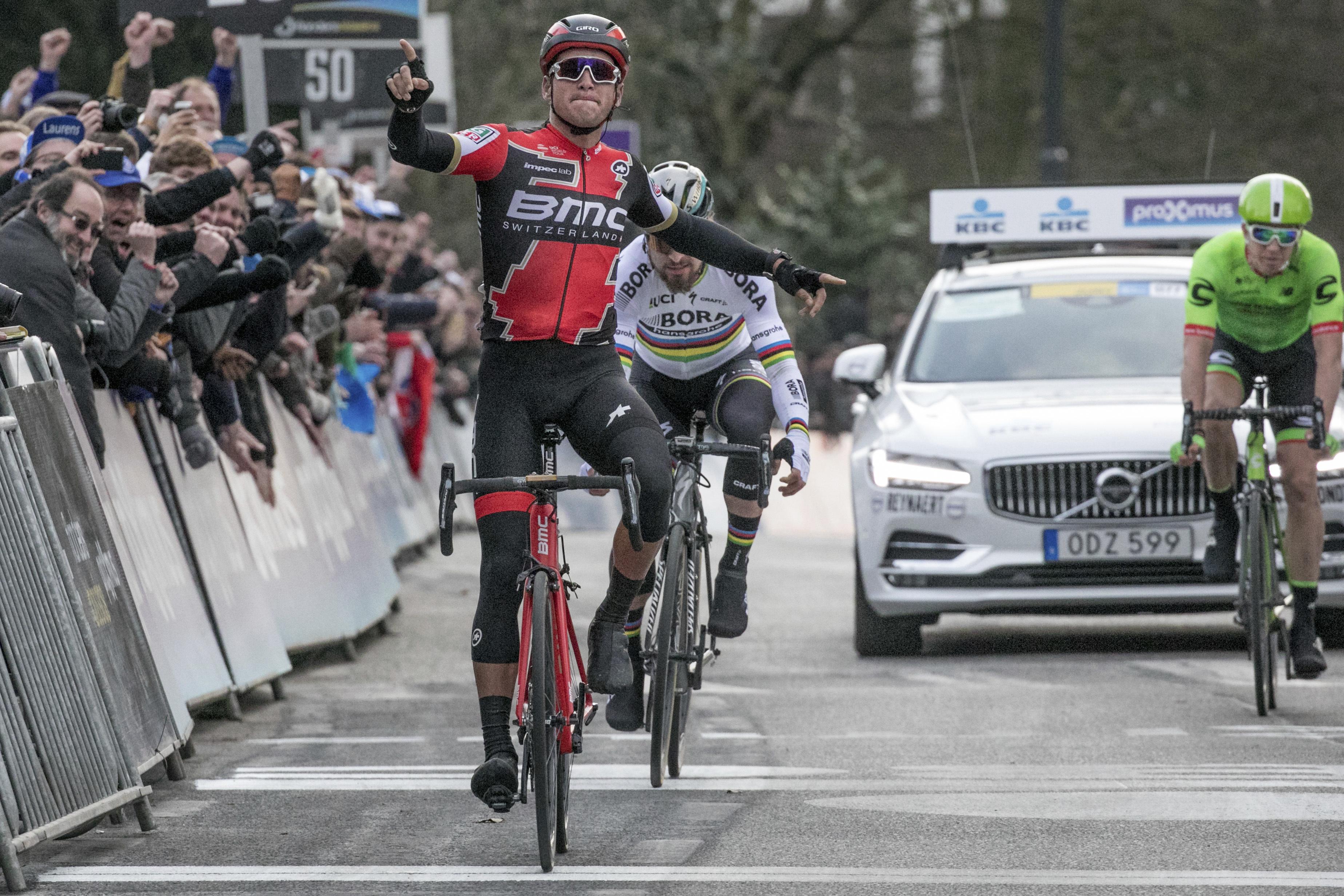 Belgian Greg Van Avermaet from BMC racing Team, front, celebrates as he wins the Belgian cycling classic Omloop Het Nieuwsblad in Ghent, Belgium, on Saturday, Feb. 25, 2017. Slovak Peter Sagan from Bora-Hansgrohe and Belgian Sep Vanmarcke from Cannondale-