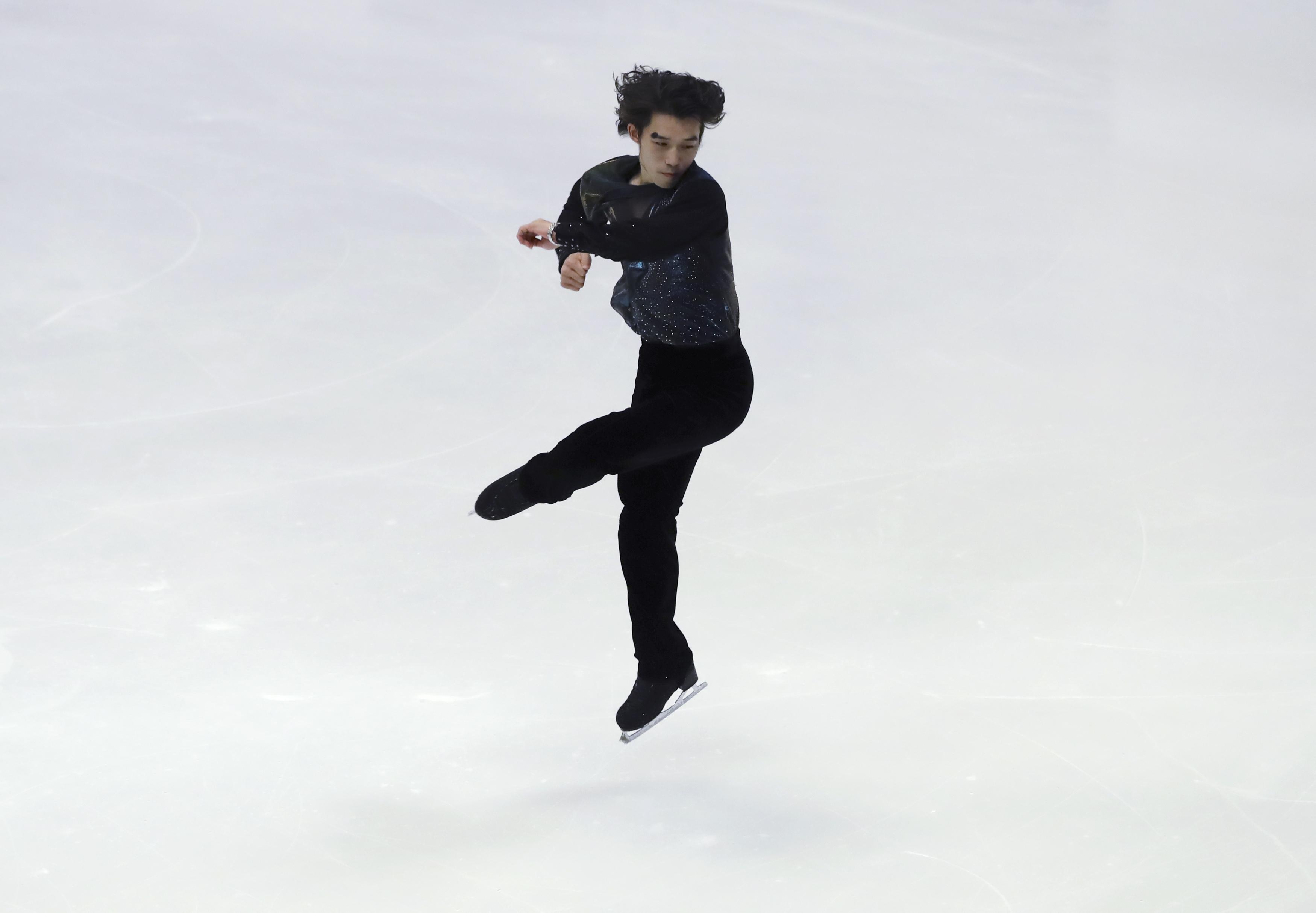 Takahito Mura of Japan performs in the Men's Free Skating program of Figure Skating competition at Makomanai Indoor Skating Rink at the Asian Winter Games in Sapporo, northern Japan, Sunday, Feb. 26, 2017. (AP Photo/Eugene Hoshiko)