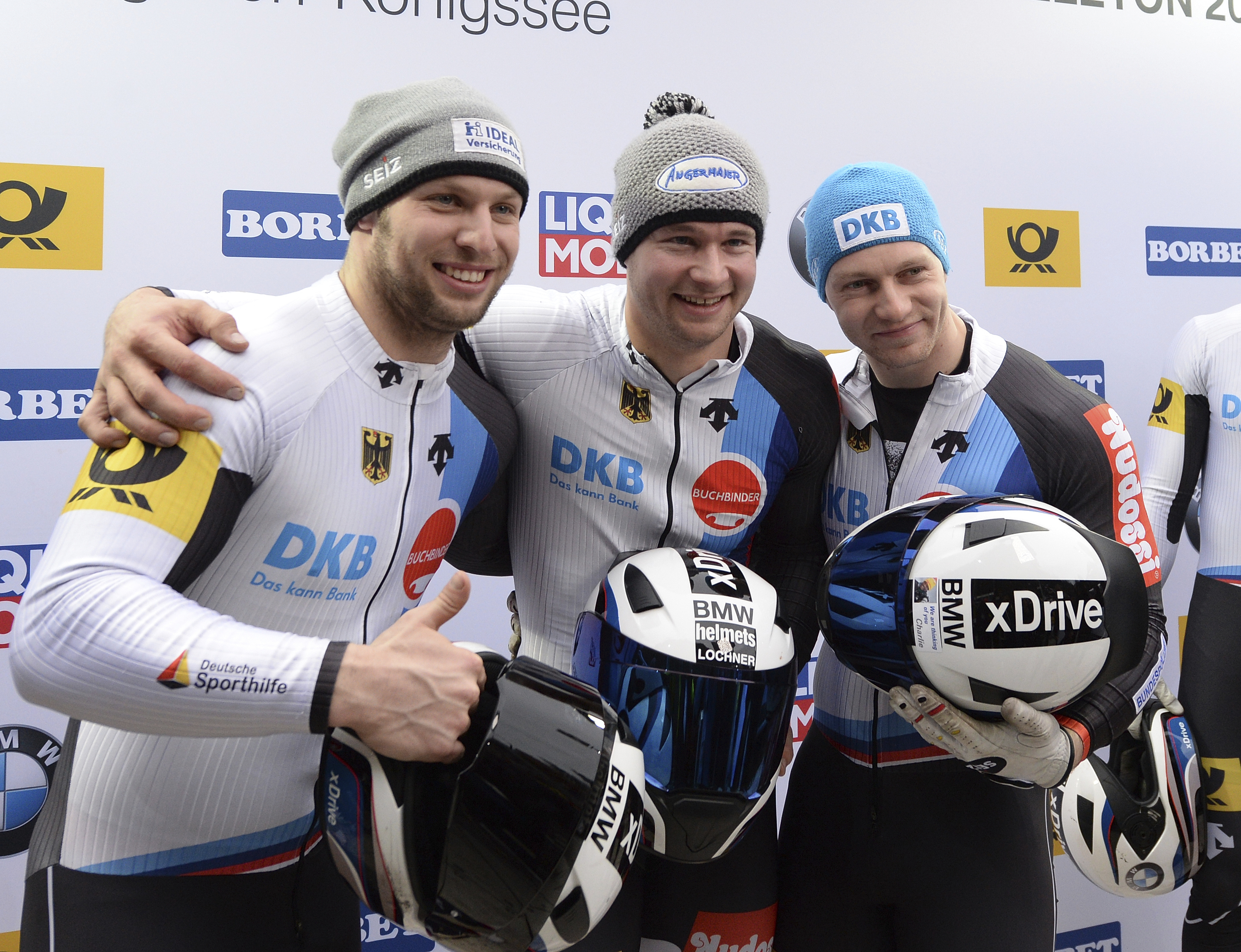 German third placed Nico Walther and the two German winners Johannes Lochner and Francesco Friedrich, from left,  celebrate after the four-men bob race at the bob and skeleton World Championships in Schoenau am Koenigssee, Germany, Sunday, Feb. 26, 2017.
