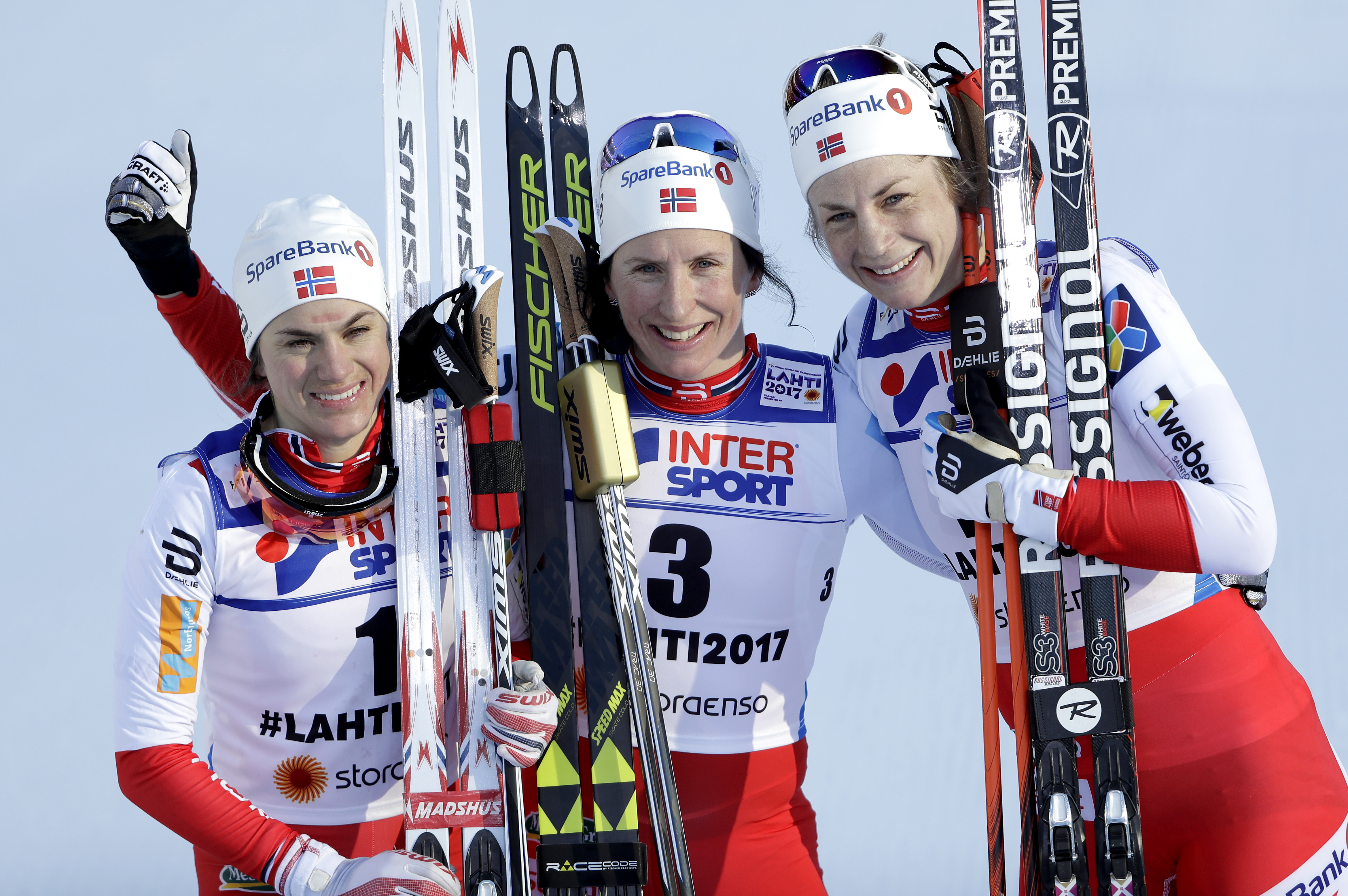 From left, second placed Norway's HeidiWeng, first placed Norway's MaritBjoergen and third placed Norway's Astrid Uhrenholdt Jacobsen pose for the media after the women's cross country 30 km mass start free competition at the 2017 Nordic Skiing World Cham