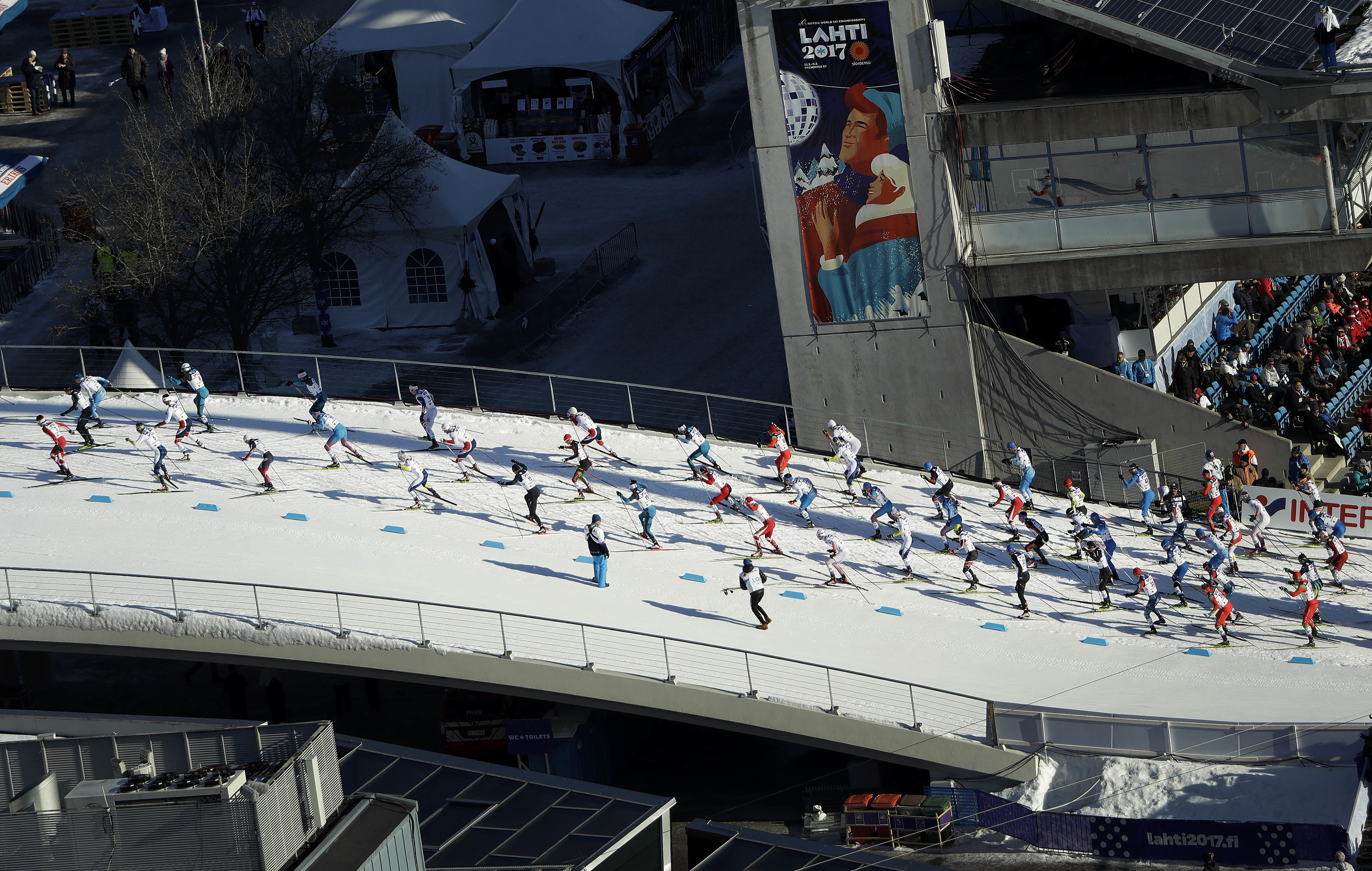 Athletes start for the men's 50 km race during the 2017 Nordic Skiing World Championships in Lahti, Finland, Sunday, March 5, 2017. (AP Photo/Matthias Schrader)