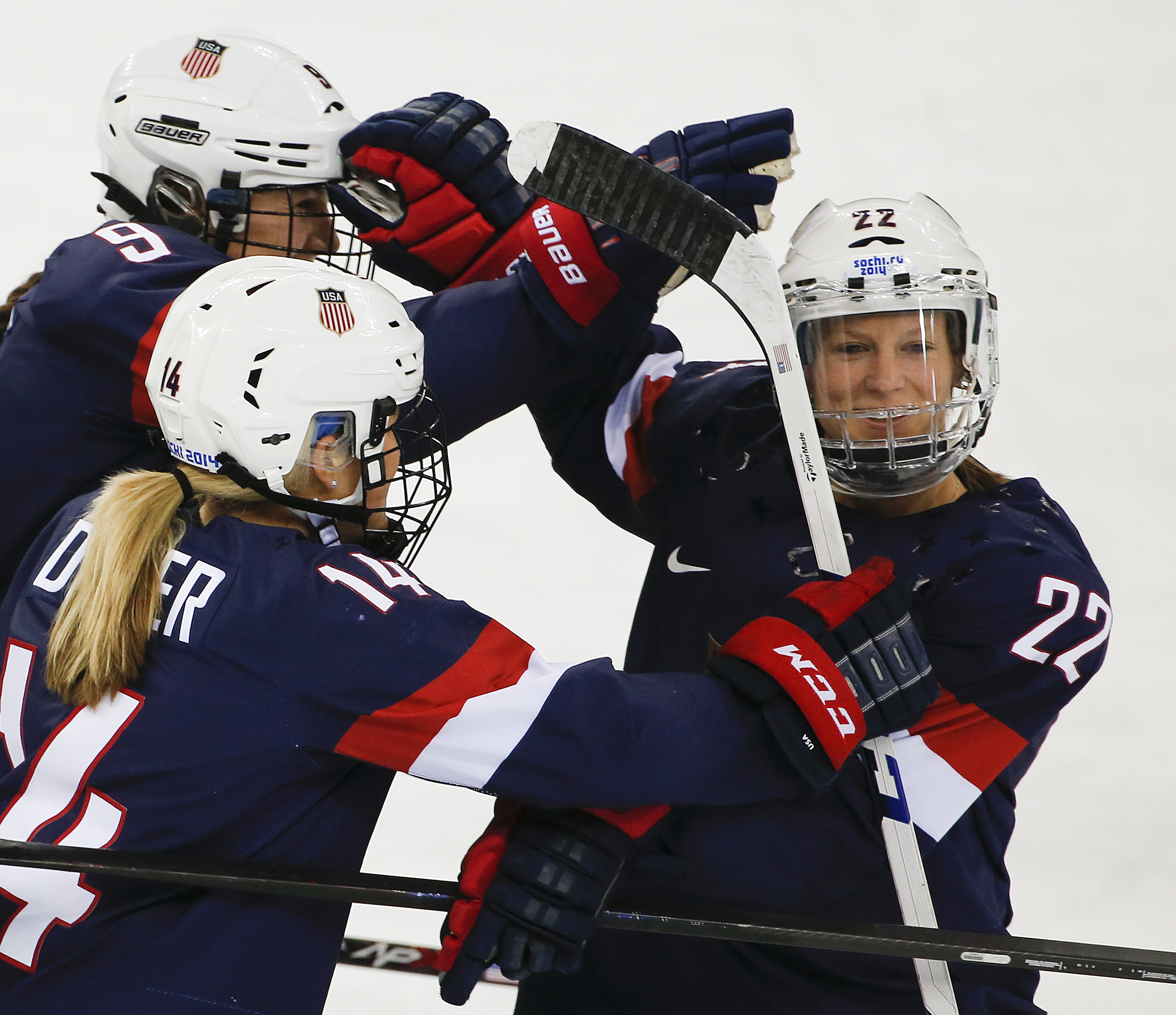 FILE - In this Feb. 17, 2014, file photo, Kacey Bellamy of the United States, right, is congratulated by teammates after scoring a goal against Sweden during the first period of the 2014 Winter Olympics women's semifinal ice hockey game  in Sochi, Russia.