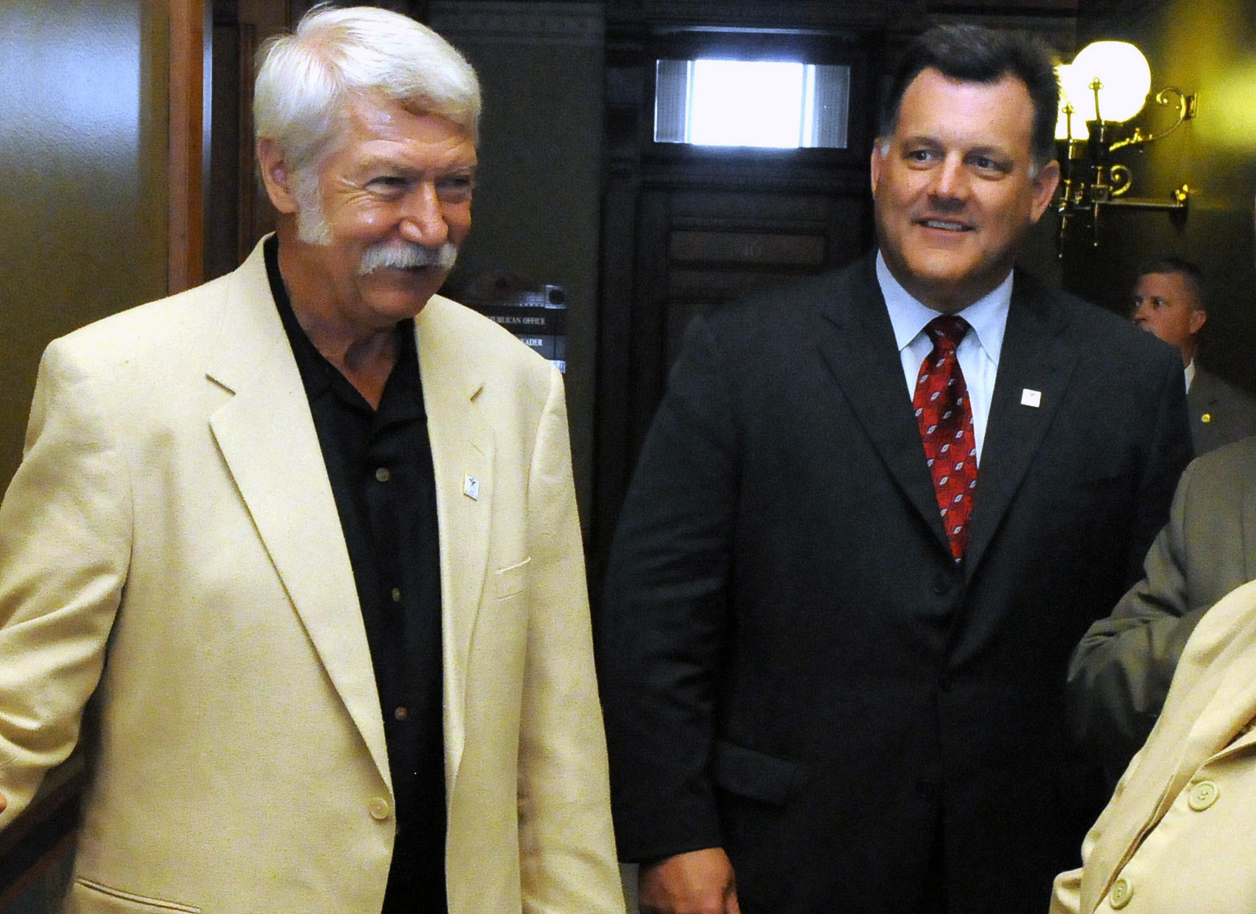 FILE - In this July 29, 2009, file photo, then-women's gymnastics coach Bela Karolyi, left, and USA gymnastics president Steve Penny talk in a hallway of the State Capitol in Hartford, Conn. Penny resigned as president of USA Gymnastics on Thursday, March