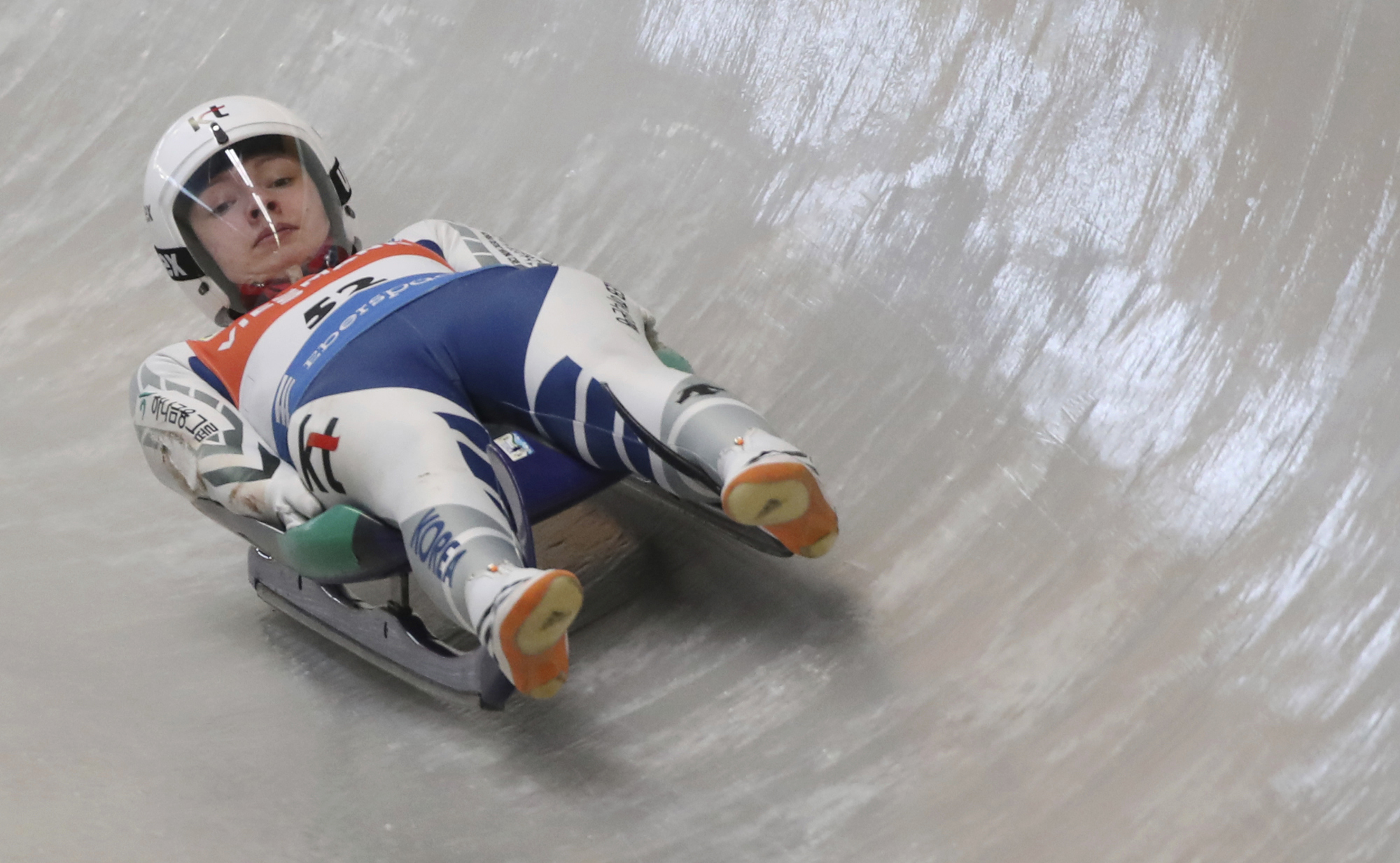 In this Thursday, Feb. 16, 2017 photo, naturalized luge athlete Aileen Frisch speeds down the track during the official training for the Luge World Cup competition at the Alpensia Sliding Centre in Pyeongchang, South Korea. South Korea has recruited forei