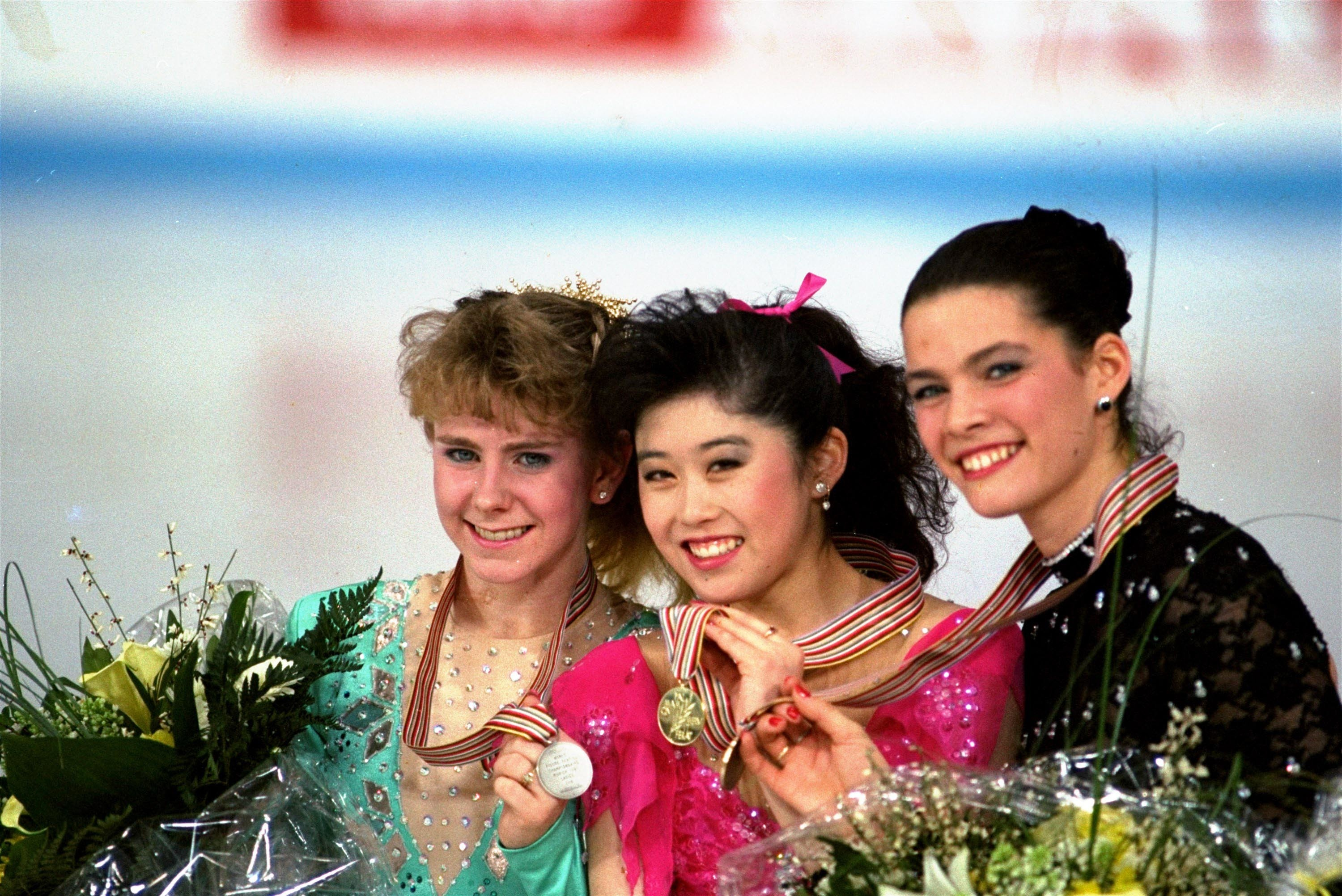 FILE - In this March 12, 1991, file photo, American skaters (L to R) Tonya Harding, silver; Kristi Yamaguchi, gold; and Nancy Kerrigan, bronze, display their medals after the finals of the World Figure Skating Championships in Munich. A run-of-the-mill go
