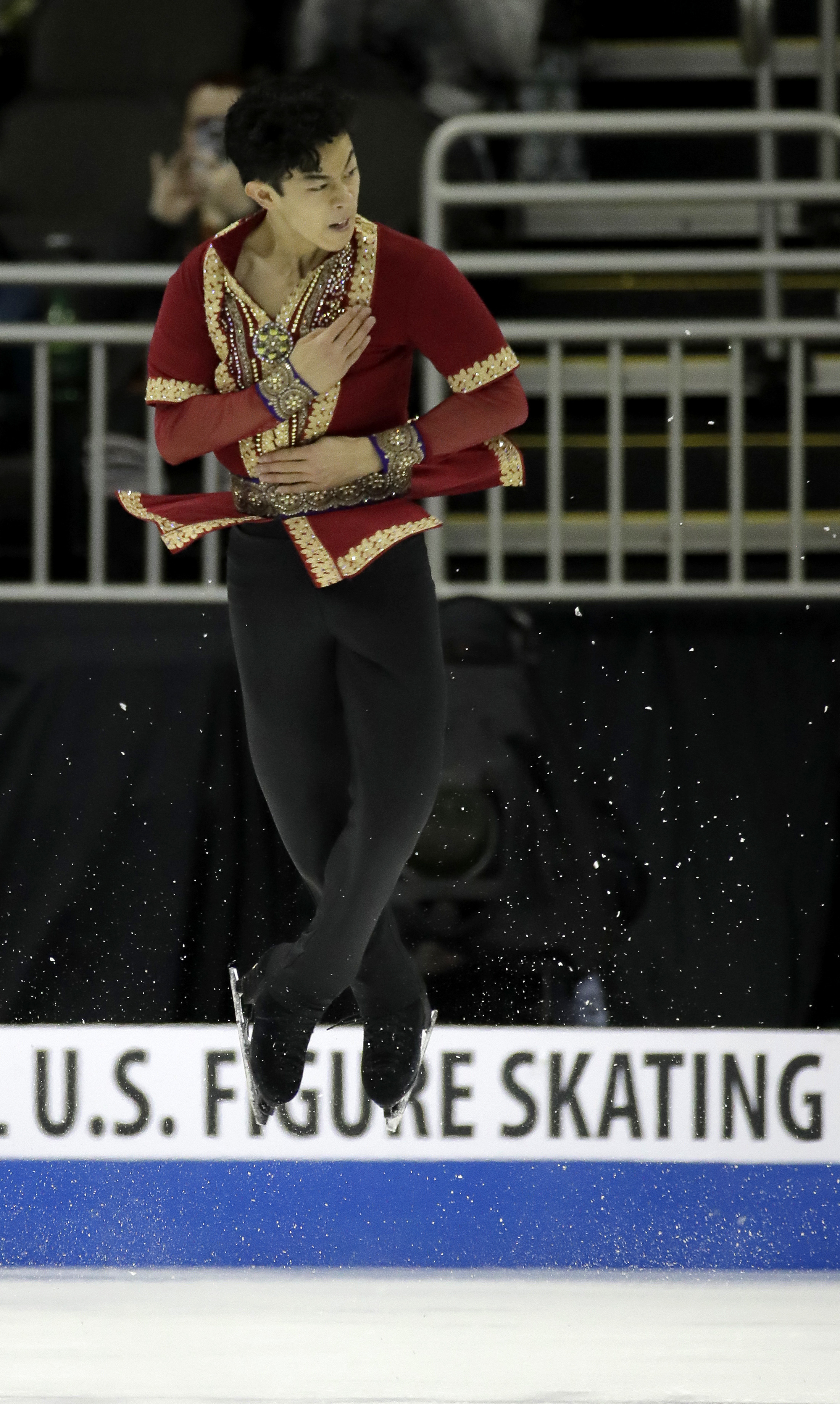 FILE - In this Jan. 22, 2017, file photo, Nathan Chen performs during the men's free skate at the U.S. Figure Skating Championships in Kansas City, Mo. Among those who thought the technical bar in men's skating couldn't go higher after the 2014 Olympics w