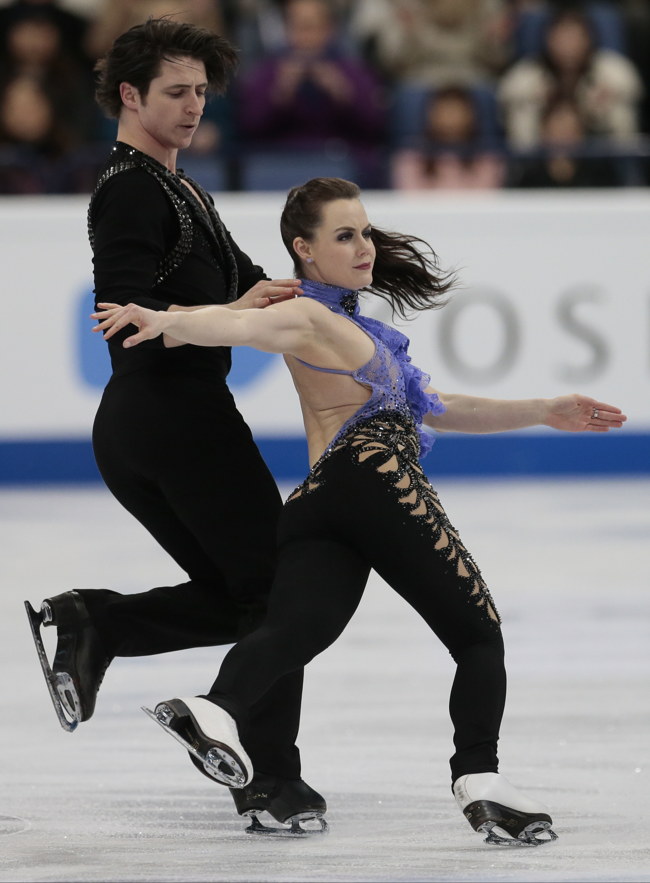 Tessa Virtue and Scott Moir, of Canada, skate their short dance at the World figure skating championships in Helsinki, Finland, on Friday, March 31, 2017. (AP Photo/Ivan Sekretarev)
