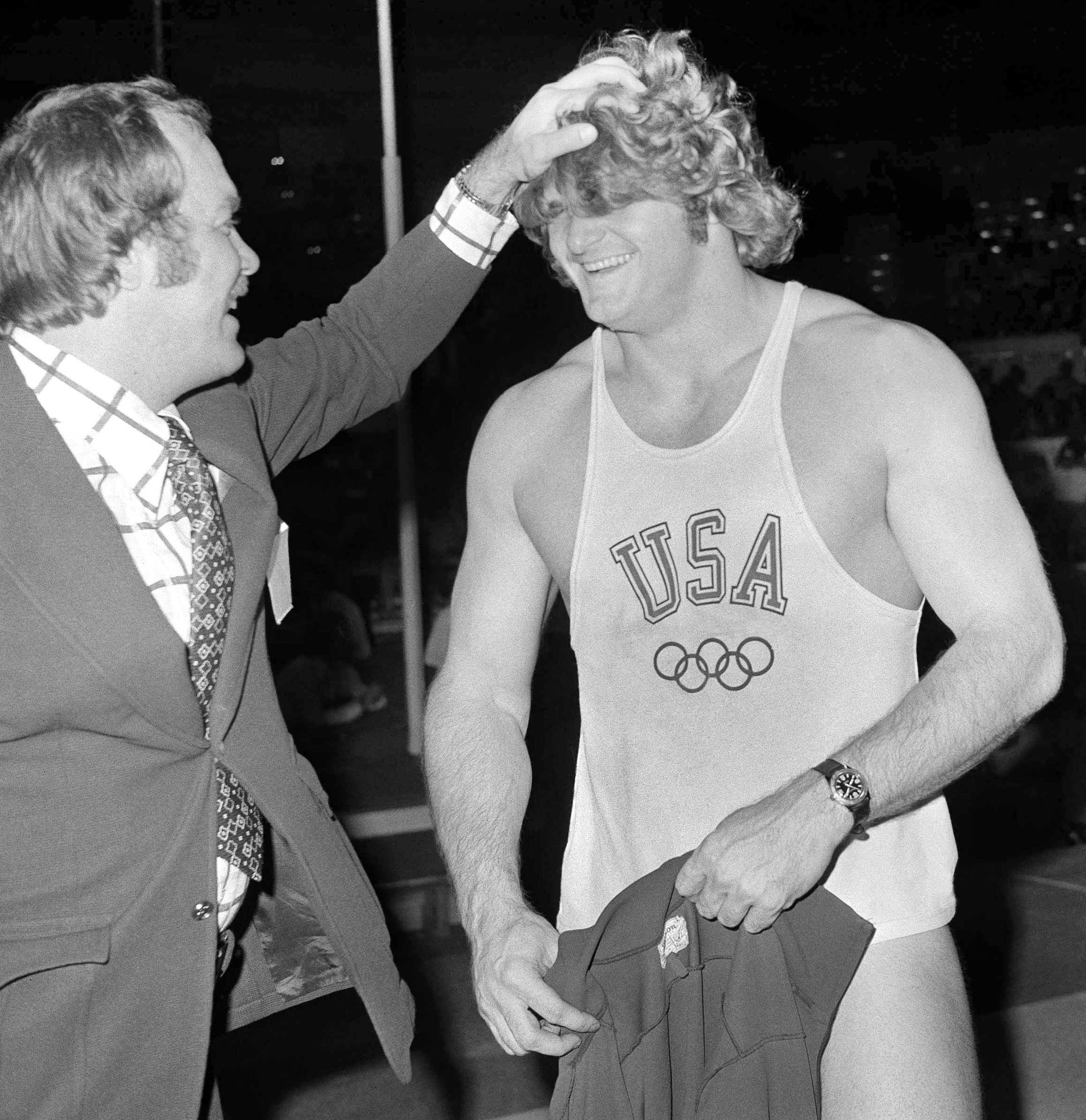 In this April 2, 1973, file photo,  Brian Oldfield, a Munich Olympian, is all smiles as he is congratulated after he bettered the world indoor shot put record with a heave of 69 feet, 11.5 inches at the International Track Association's athletics meet at