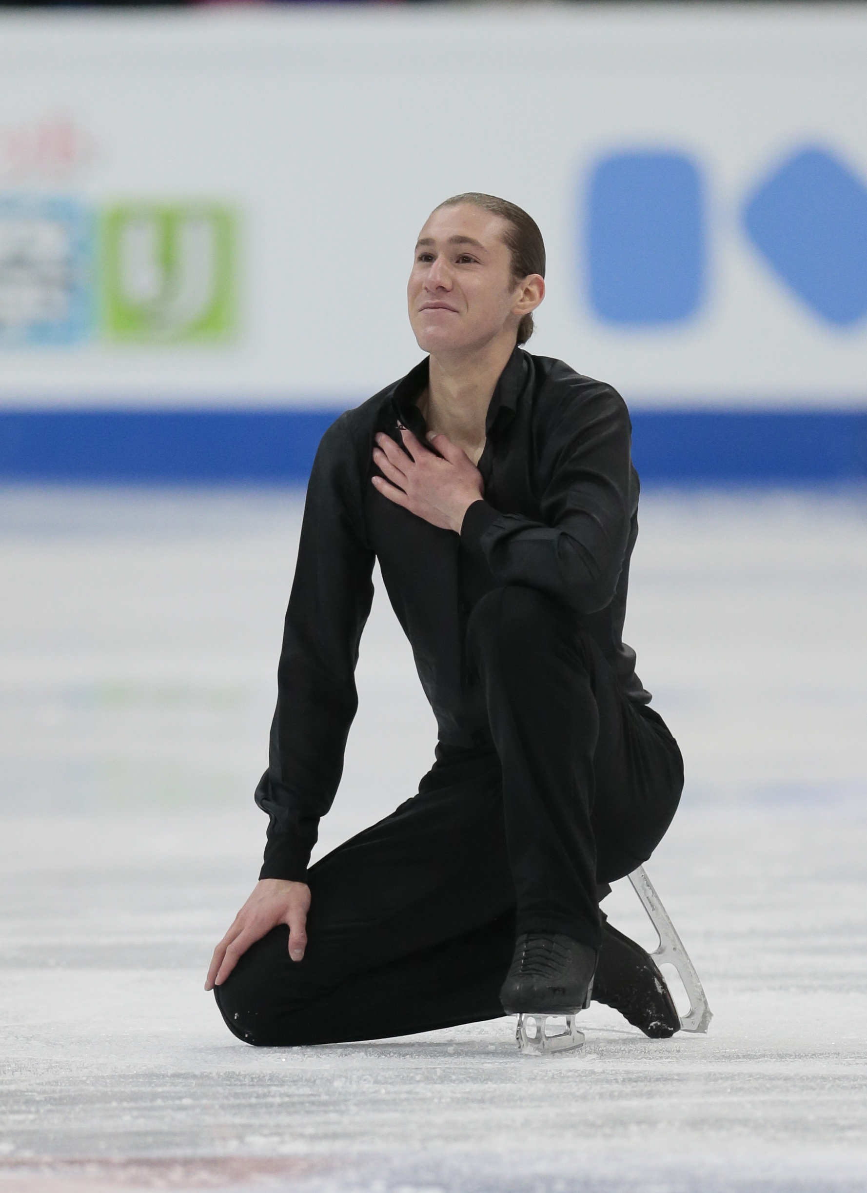 Jason Brown, of the United States, reacts after skating his free program at the World figure skating championships in Helsinki, Finland, on Saturday, April 1, 2017. (AP Photo/Ivan Sekretarev)