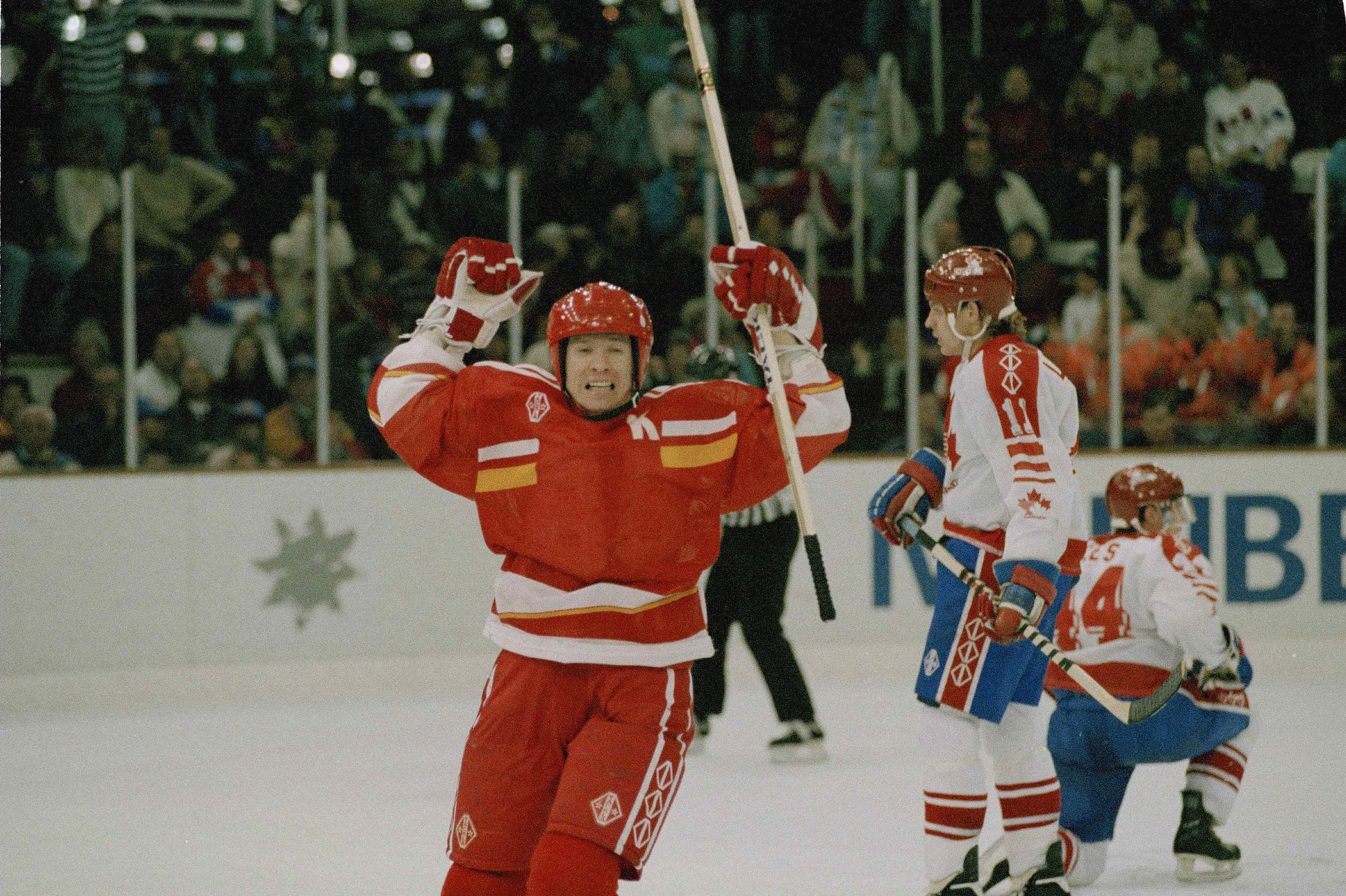 FILE - In this Feb. 23, 1992, file photo, Vyacheslav Bykov of the Unified Team celebrates after scoring the third goal against Canada during the ice hockey final of the XVI Winter Olympics in Maribel, France. After a week of turmoil for Olympic hockey, Ru