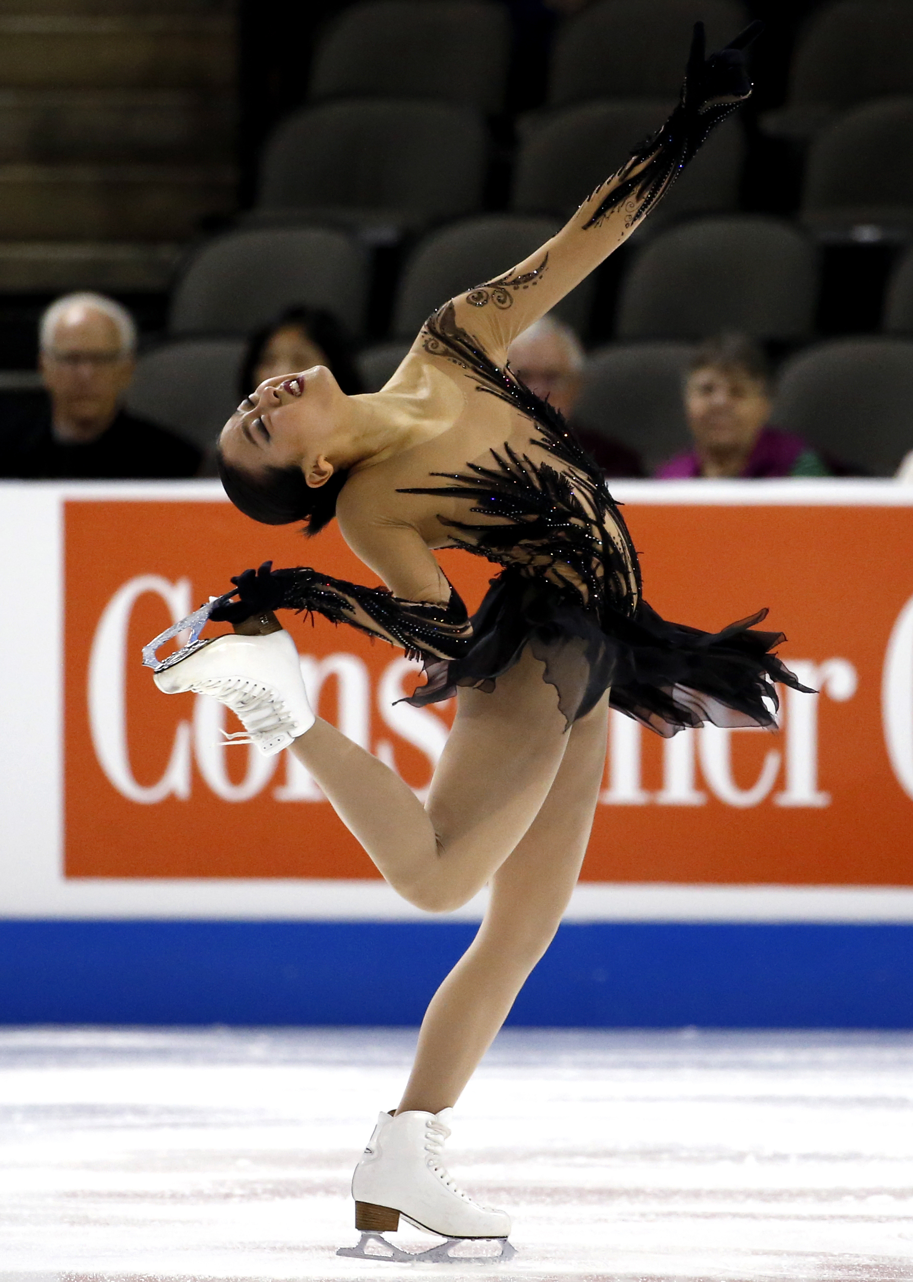 FILE - In this Oct. 21, 2016, file photo, Mao Asada, of Japan, competes in women's short program at the Skate America figure skating event, in Hoffman Estates, Ill. Mao Asada says she has decided to retire. The 26-year-old Asada, a silver medalist at the