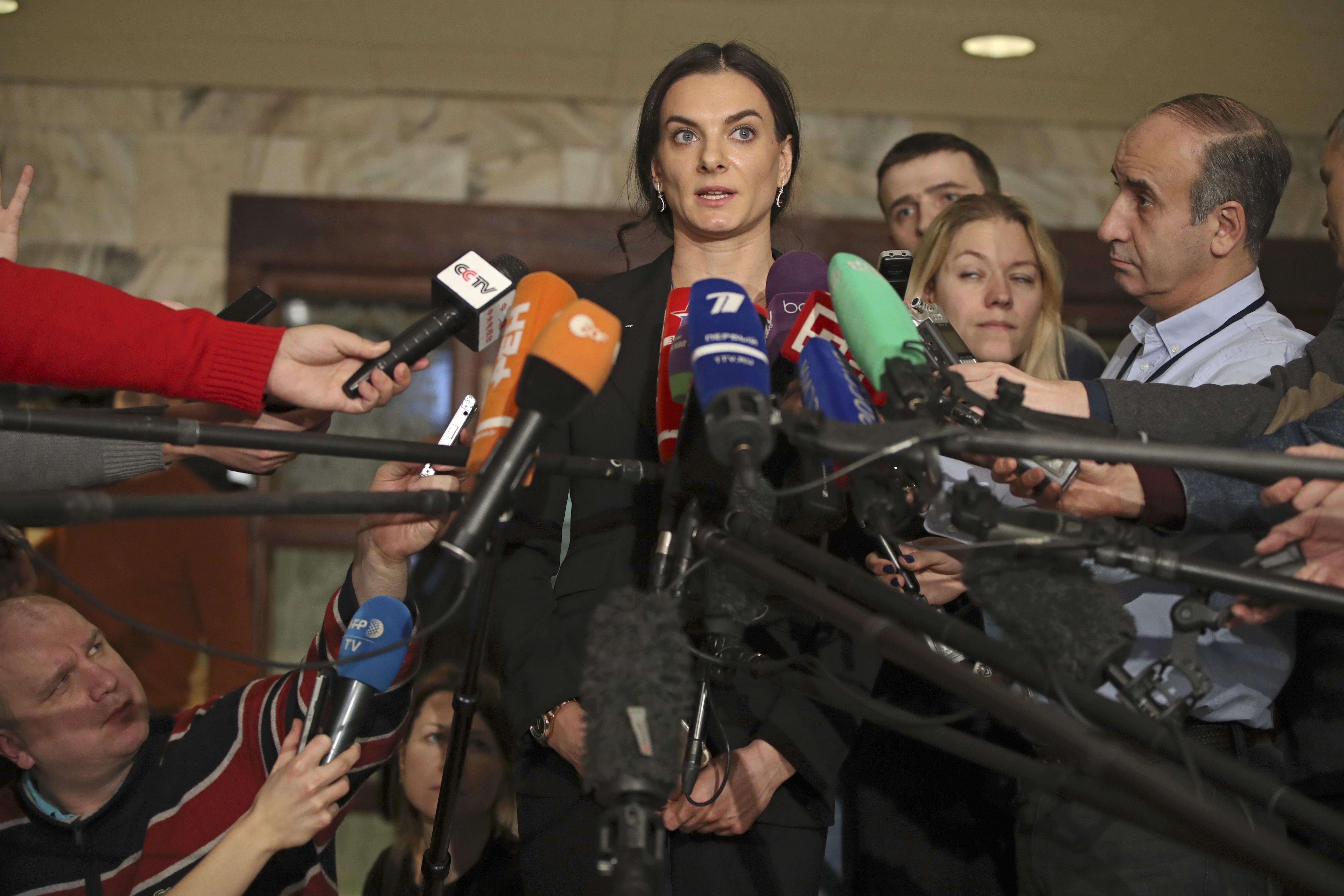 "FILE - In this Friday, Dec. 9, 2016 file photo, former Russian pole vaulter Yelena Isinbayeva speaks to the media in Moscow, Russia. The IAAF says Russia is making ""little progress"" cleaning up its doping culture to secure its reinstatement into athletics"
