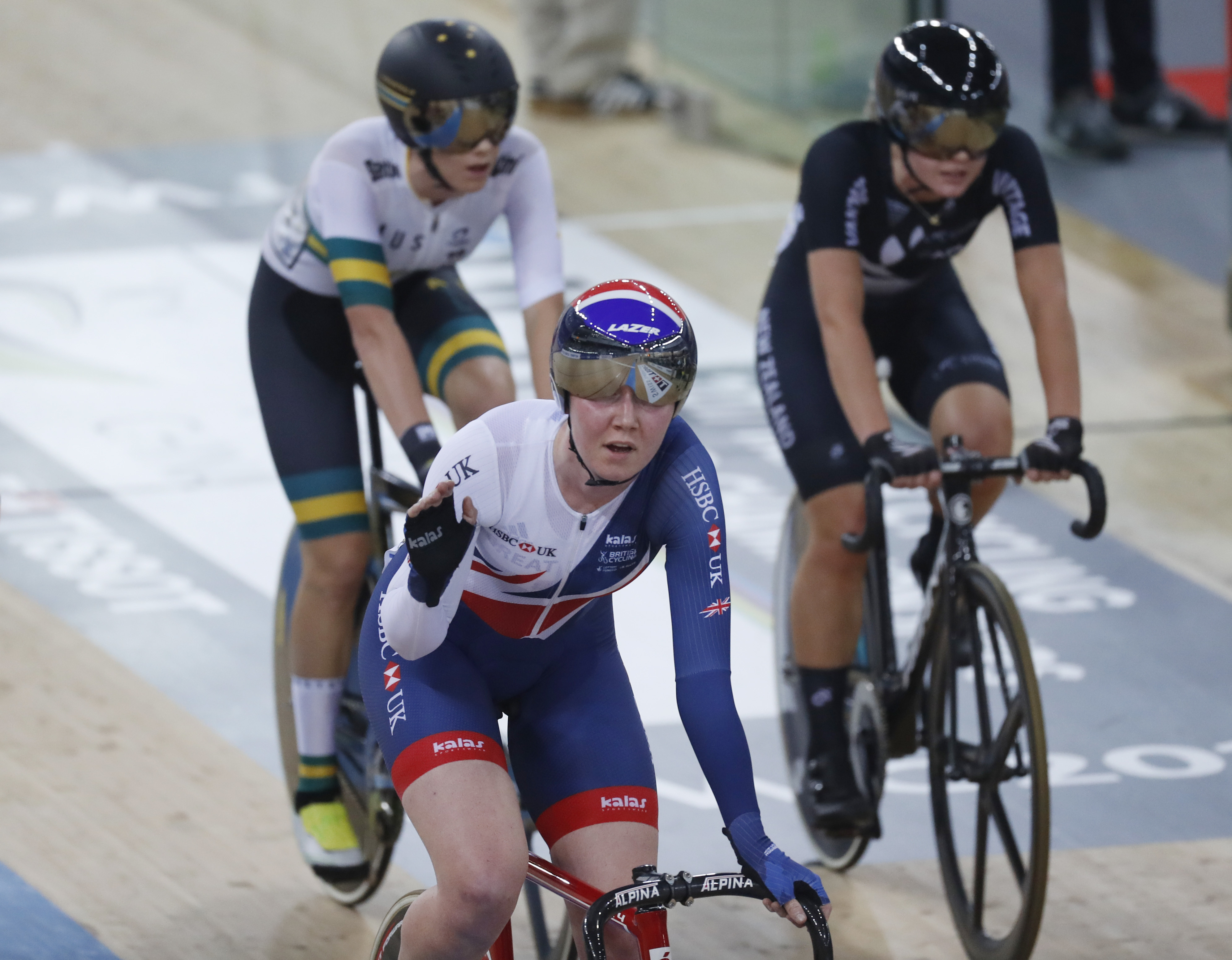 Britain's Katie Archibald, center, reacts after she finished the Women's Omnium Tempo Race 2\4 at the World Track Cycling championships in Hong Kong, Friday, April 14, 2017. (AP Photo/Kin Cheung)