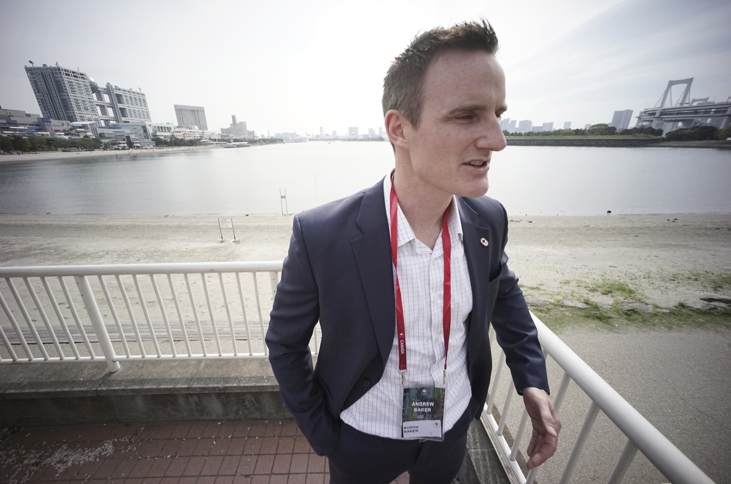 In this Thursday, April 20, 2017 photo, Andrew Baker, Games Director of the Canadian Olympic Committee, speaks at Odaiba Seaside Park, the venue of the Tokyo 2020 Summer Olympic and Paralympic Games, during an interview with The Associated Press in Tokyo.