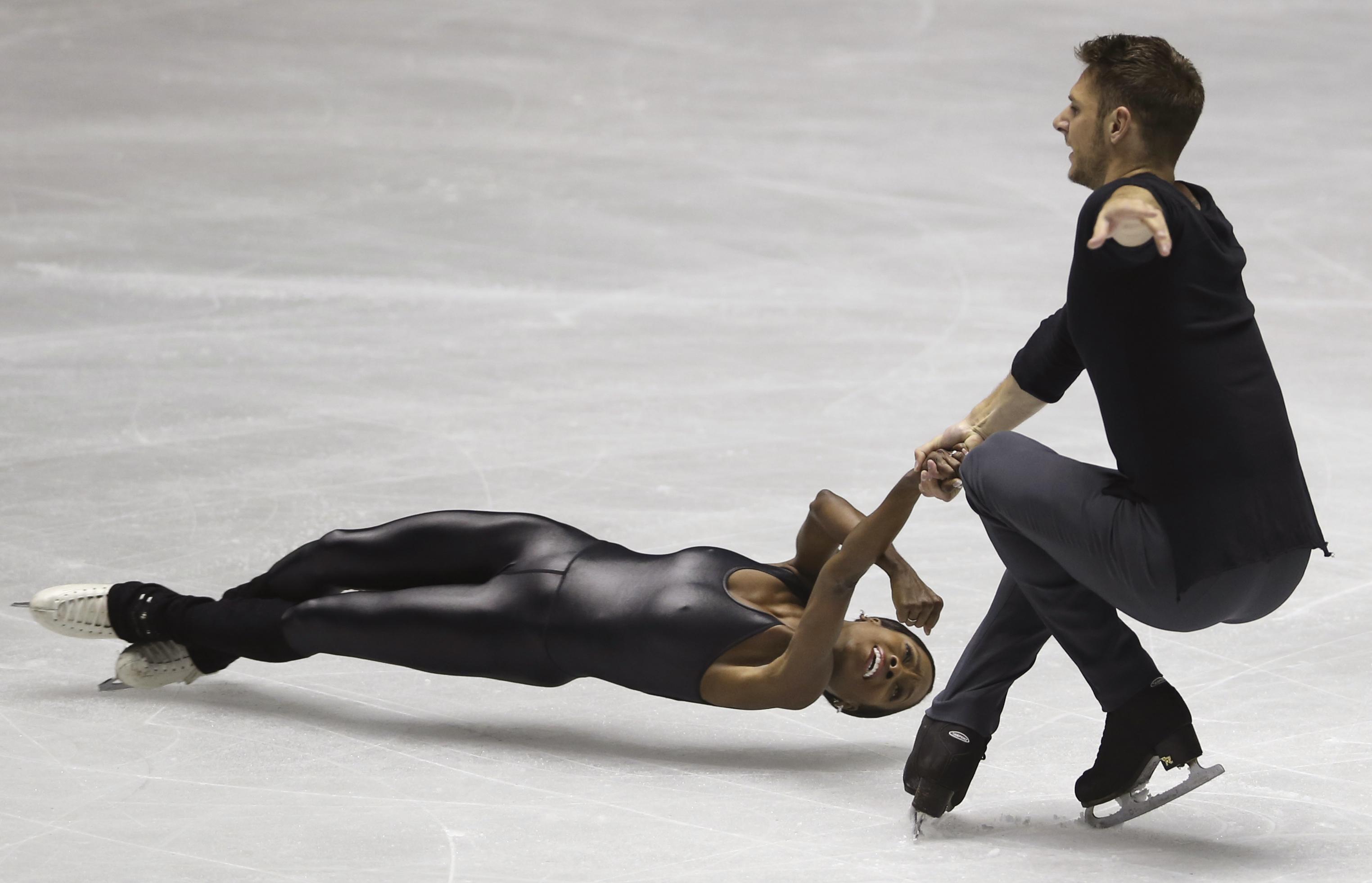 French pair Vanessa James and Morgan Cipres perform during their pairs free skating of World Team Trophy Figure Skating in Tokyo, Saturday, April 22, 2017. (AP Photo/Koji Sasahara)