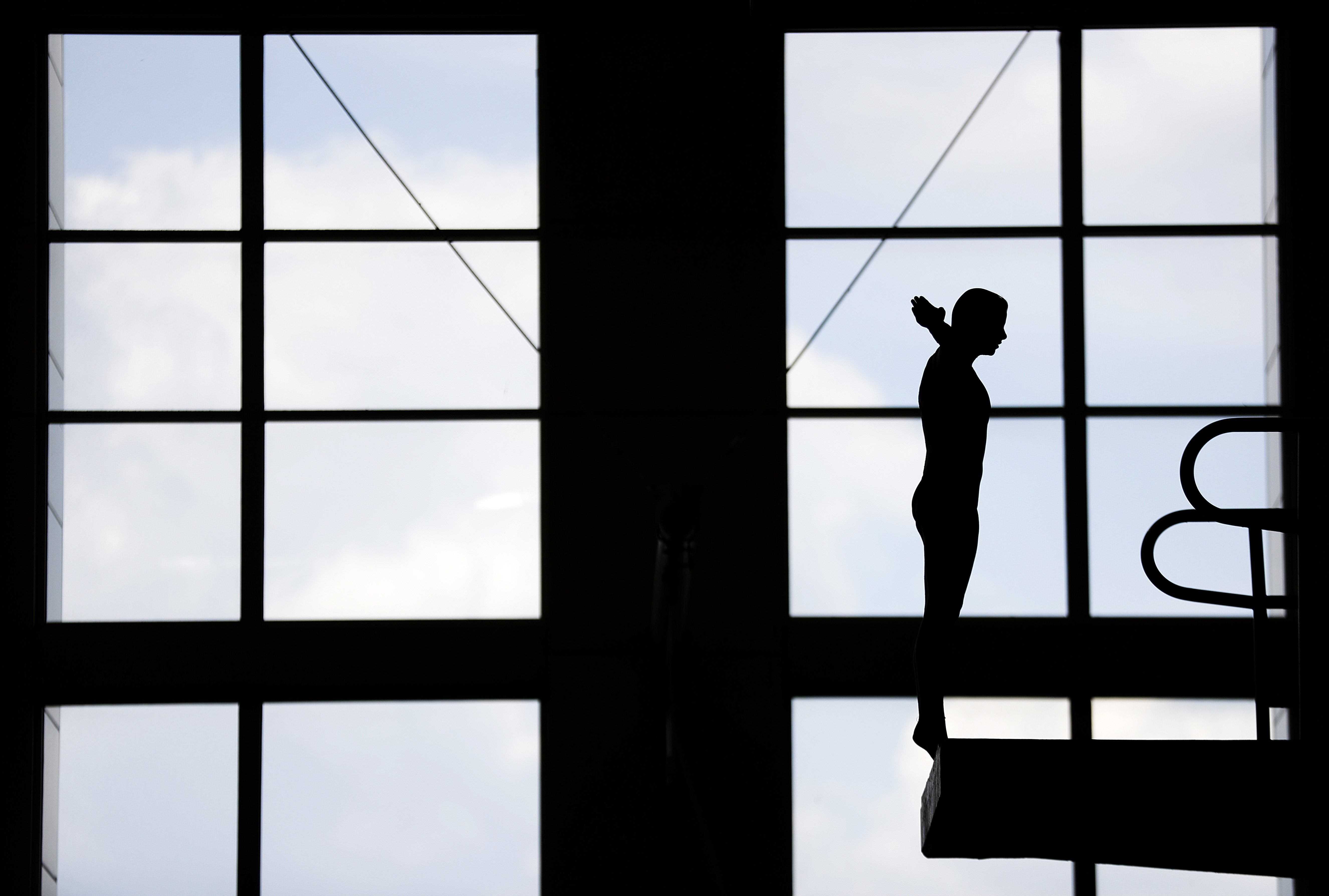 In this Friday, April 14, 2017 photo, Tarrin Gilliland takes a practice dive during the U.S. Diving Synchronized National Championships at Georgia Tech in Atlanta. These days, the pool deck seems a little empty for the U.S. diving team as David Boudia, th