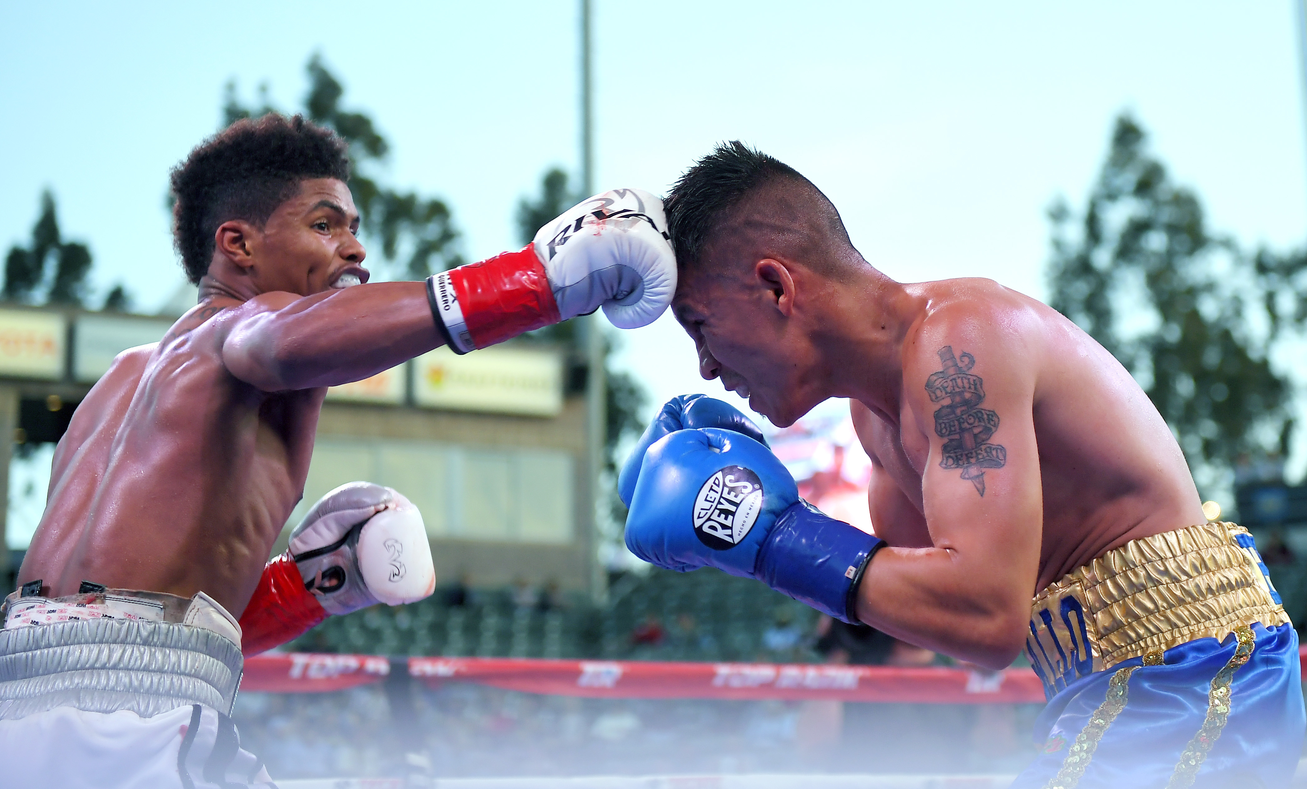 Shakur Stevenson, left, connects with Edgar Brito during a featherweight bout, Saturday, April 22, 2017, in Carson, Calif. (AP Photo/Mark J. Terrill)