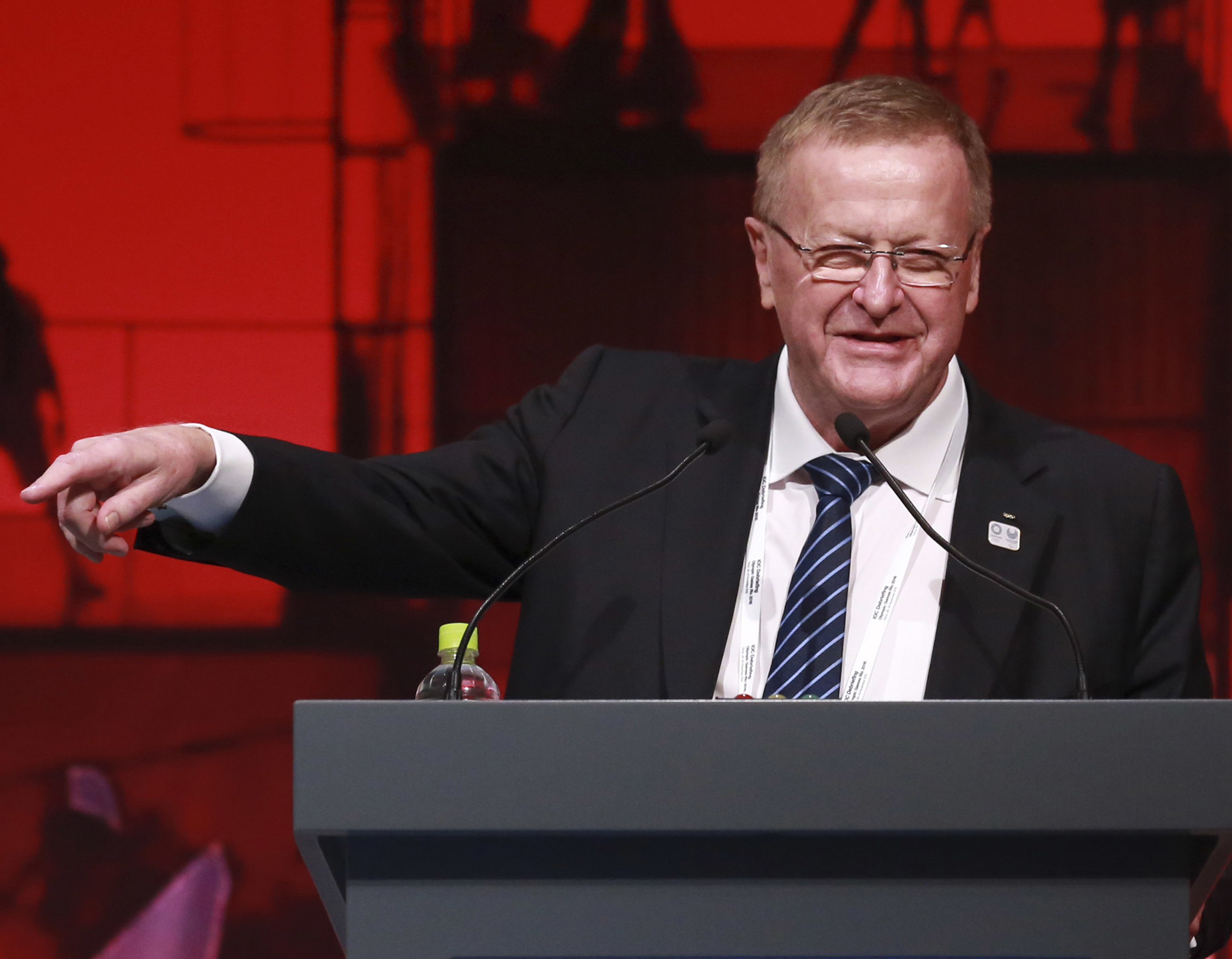 FILE - In this Nov. 30, 2016, file photo, IOC Vice President John Coates delivers a speech during the closing plenary session of the IOC Debriefing of the Olympic Games Rio 2016, in Tokyo. An increasingly bitter Olympic election in Australia has intensifi