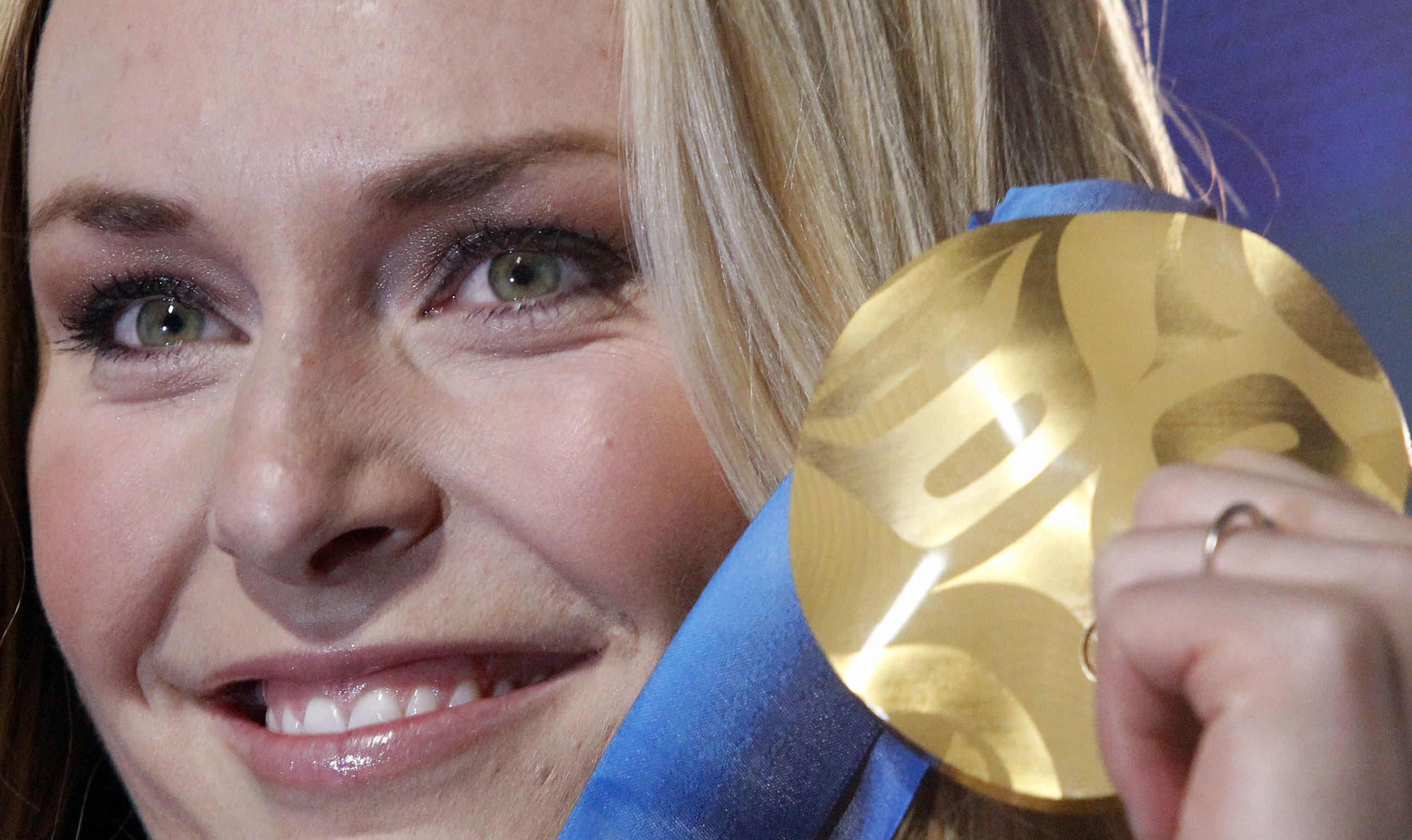 FILE - In this Feb. 17, 2010, file photo, Lindsey Vonn of the United States, shows the gold medal she won in the Women's downhill, during the medal ceremony at the Vancouver 2010 Olympics in Whistler, British Columbia.  In the twilight of her career, Vonn