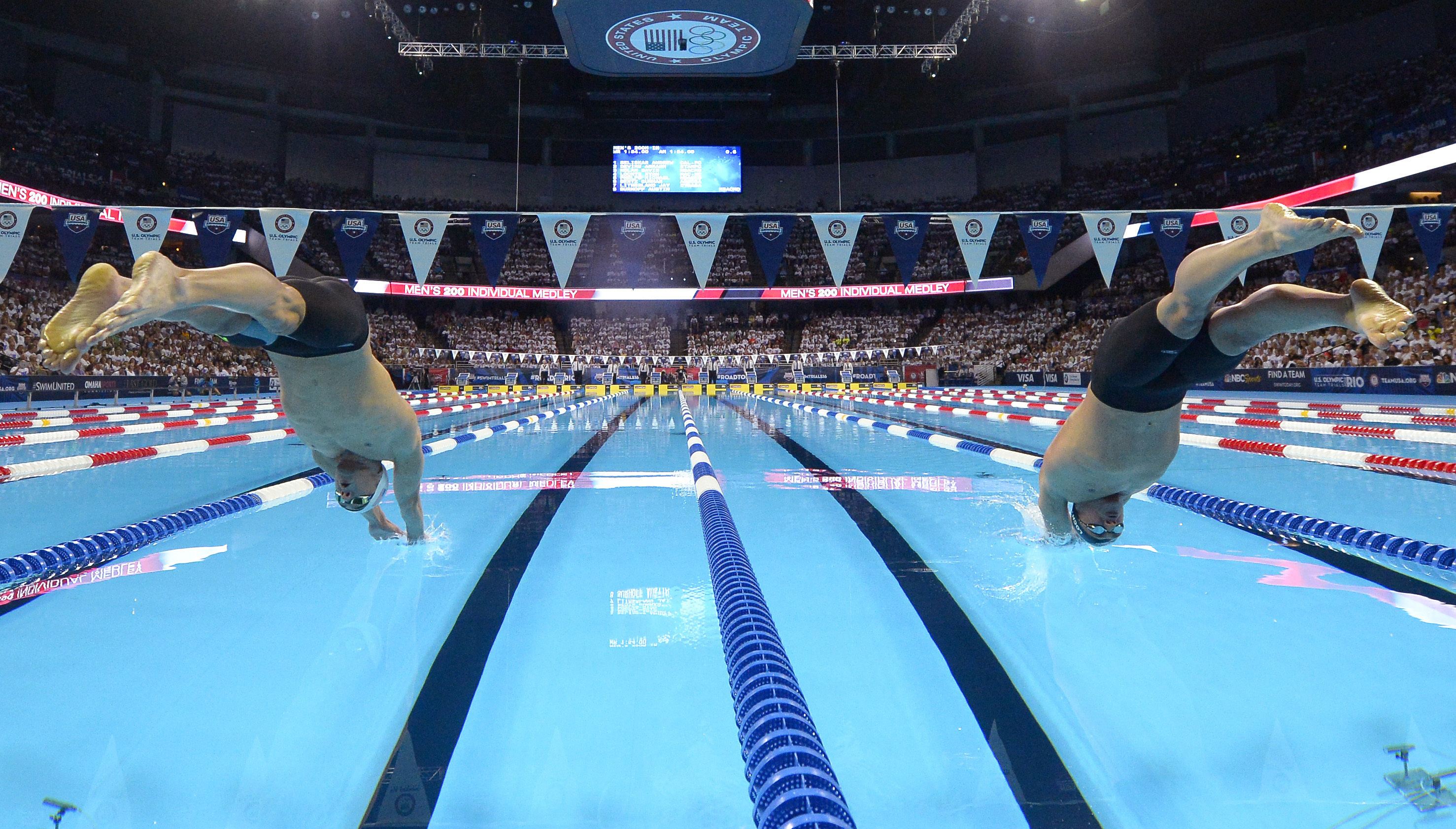 FILE - In this July 1, 2016, file photo, Michael Phelps, left, and Ryan Lochte start the men's 200-meter individual medley at the U.S. Olympic swimming trials, in Omaha, Neb. USA Swimming knew it wanted to return to Omaha for the Olympic trials in 2020, s