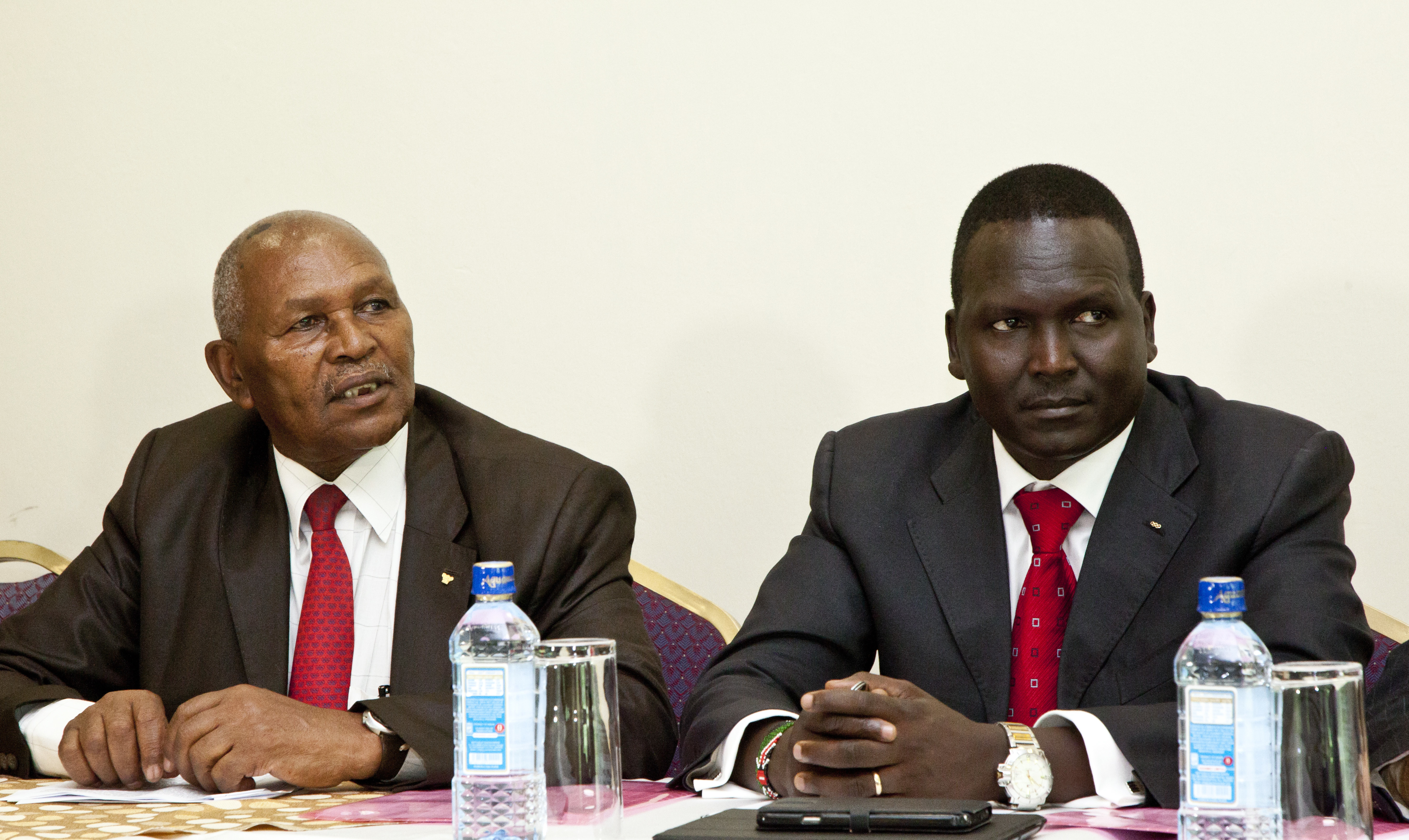 Incumbent head of the troubled National Olympic Committee of Kenya Kipchoge 'Kip' Keino, left, and candidate Paul Tergat, right, speak to the media on the day committee elections were supposed to take place in Nairobi, Kenya Friday, May 5, 2017. The Kenya