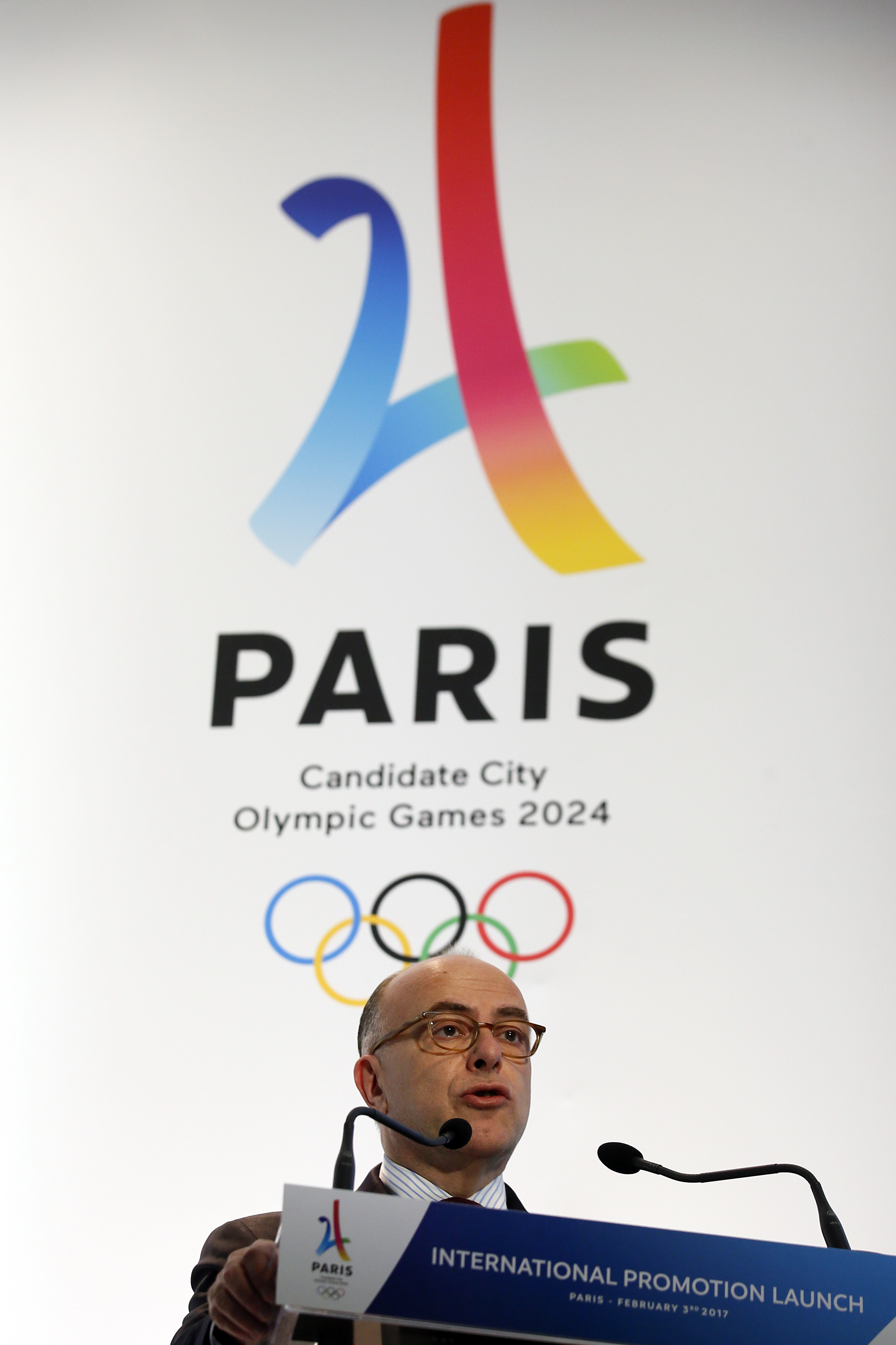 FILE - This is a  Friday, Feb. 3, 2017 file photo of French Prime Minister Bernard Cazeneuve as he delivers his speech during the launch of the international campaign of Paris as candidate for the 2024 Olympic summer games in Paris. Los Angeles and Paris
