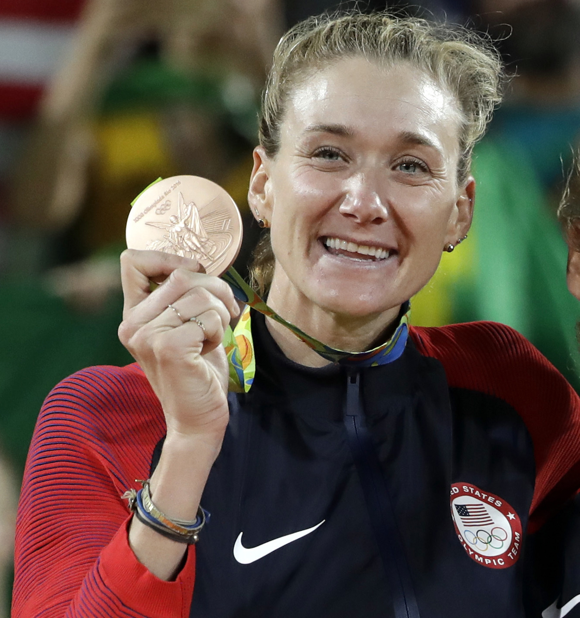 FILE - In this Aug. 18, 2016, file photo, United States' Kerri Walsh Jennings stands on the podium after winning the bronze medal in the women's beach volleyball competition of the 2016 Summer Olympics in Rio de Janeiro, Brazil. More than 100 athletes fro